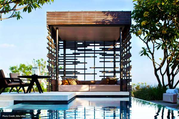 A cabana next to a pool at luxury hotel.