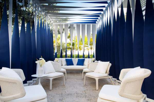 Blue and white shade structure made with Sunbrella fabrics.