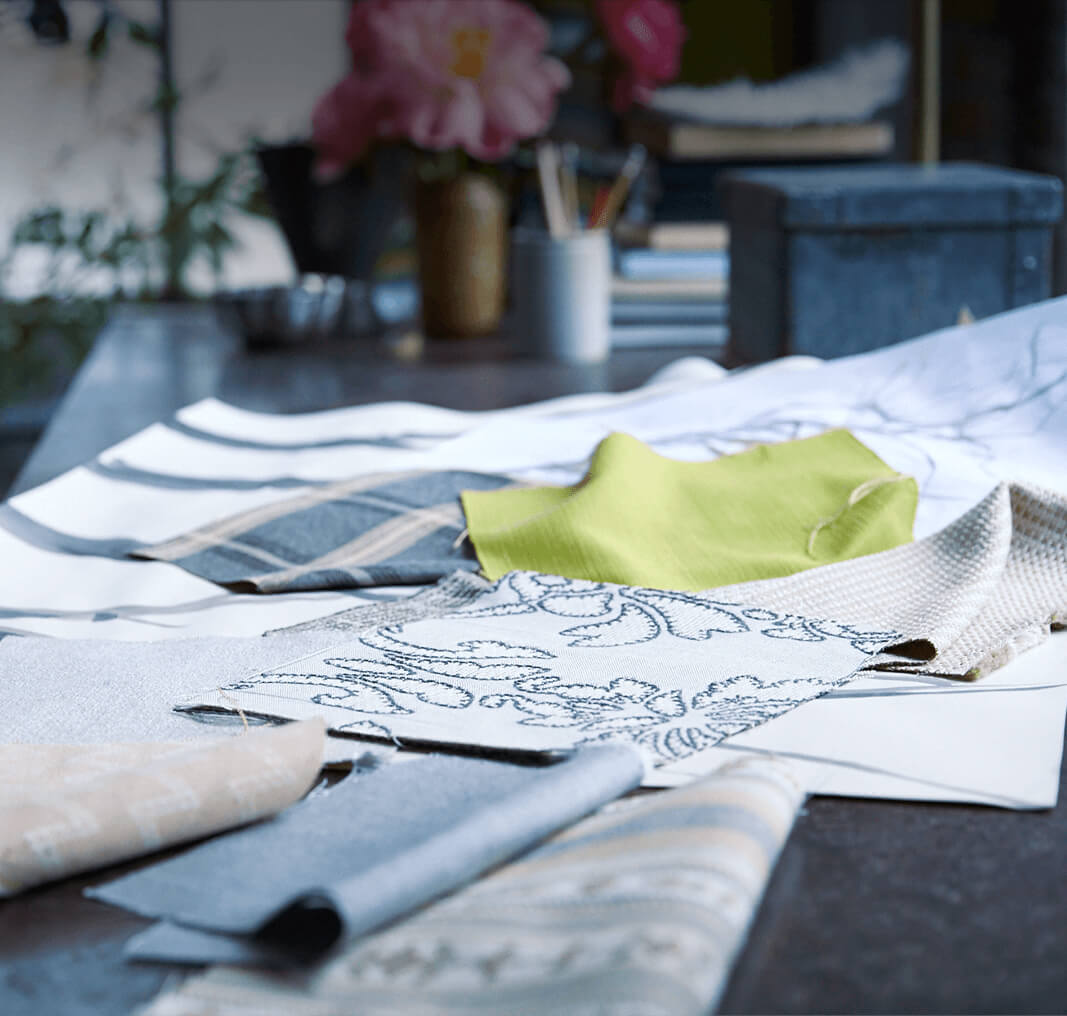 Fabric samples cut and on a designer work table