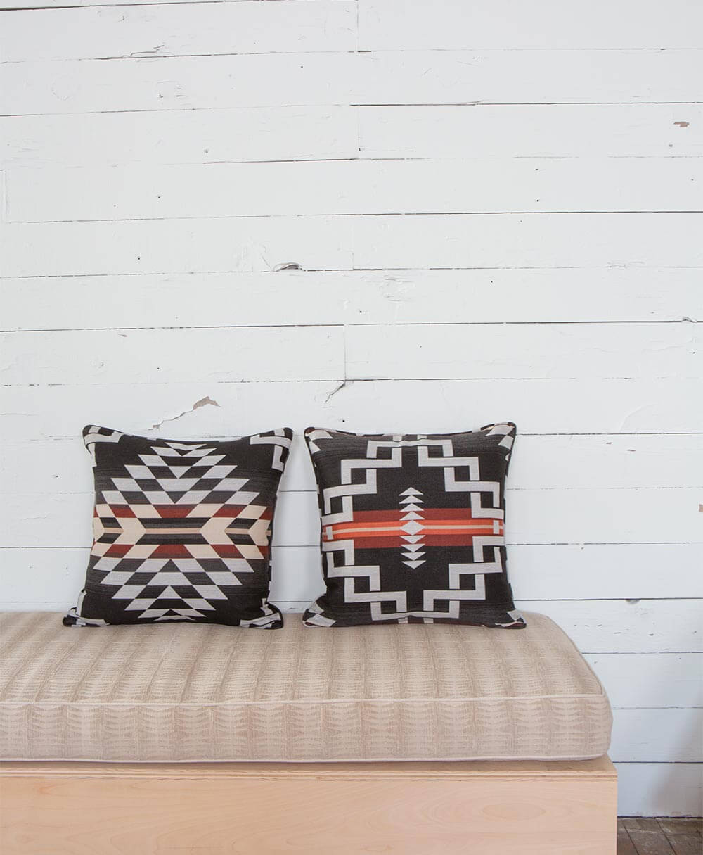 A cushion with black pillows mading using Pendleton by Sunbrella upholstery fabrics.