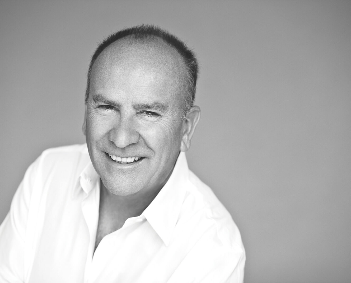 A headshot of designer Richard Frinier, who works on a line of Sunbrella fabrics
