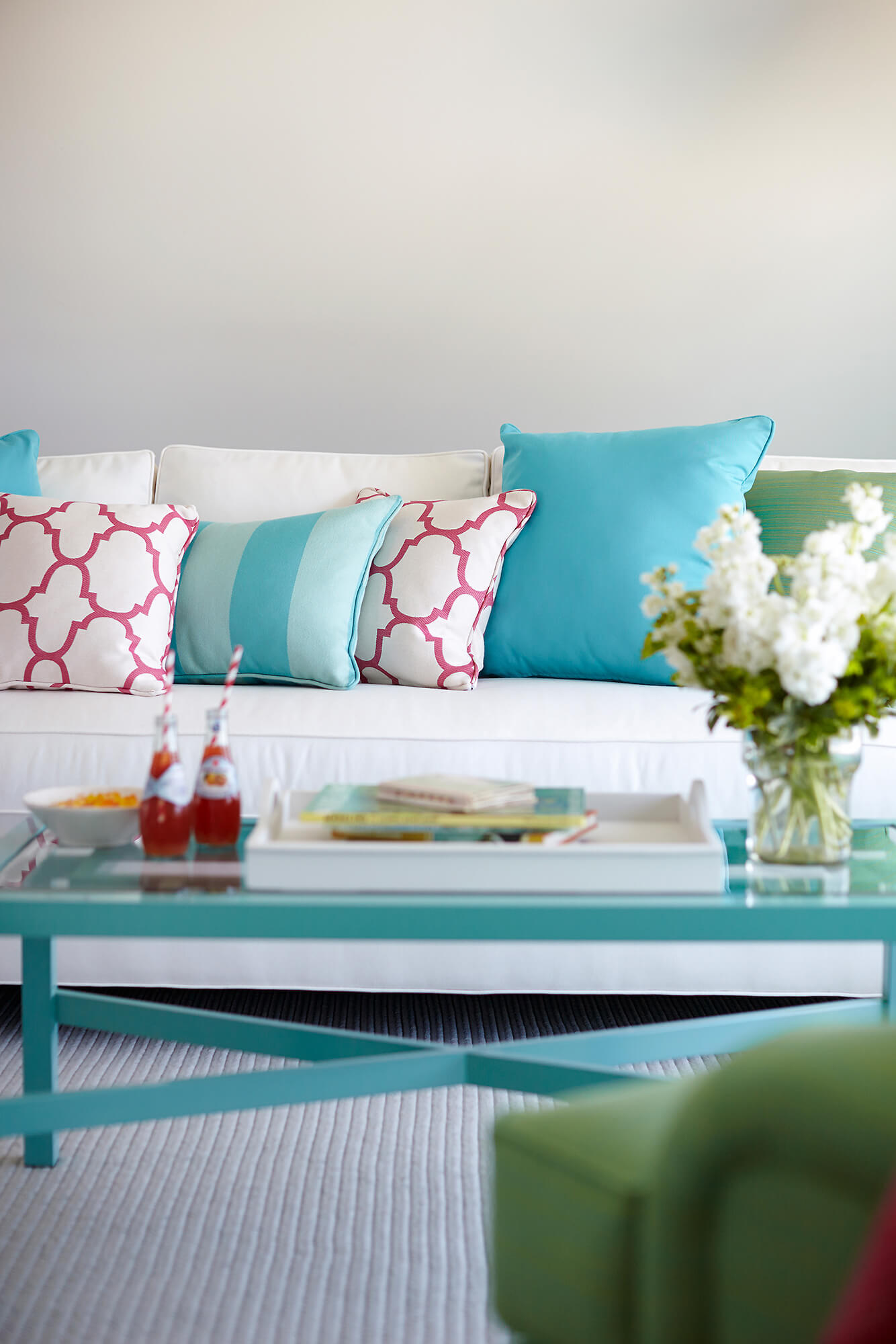 Living room with pastel shades of pink, green, and blue is soft and chic