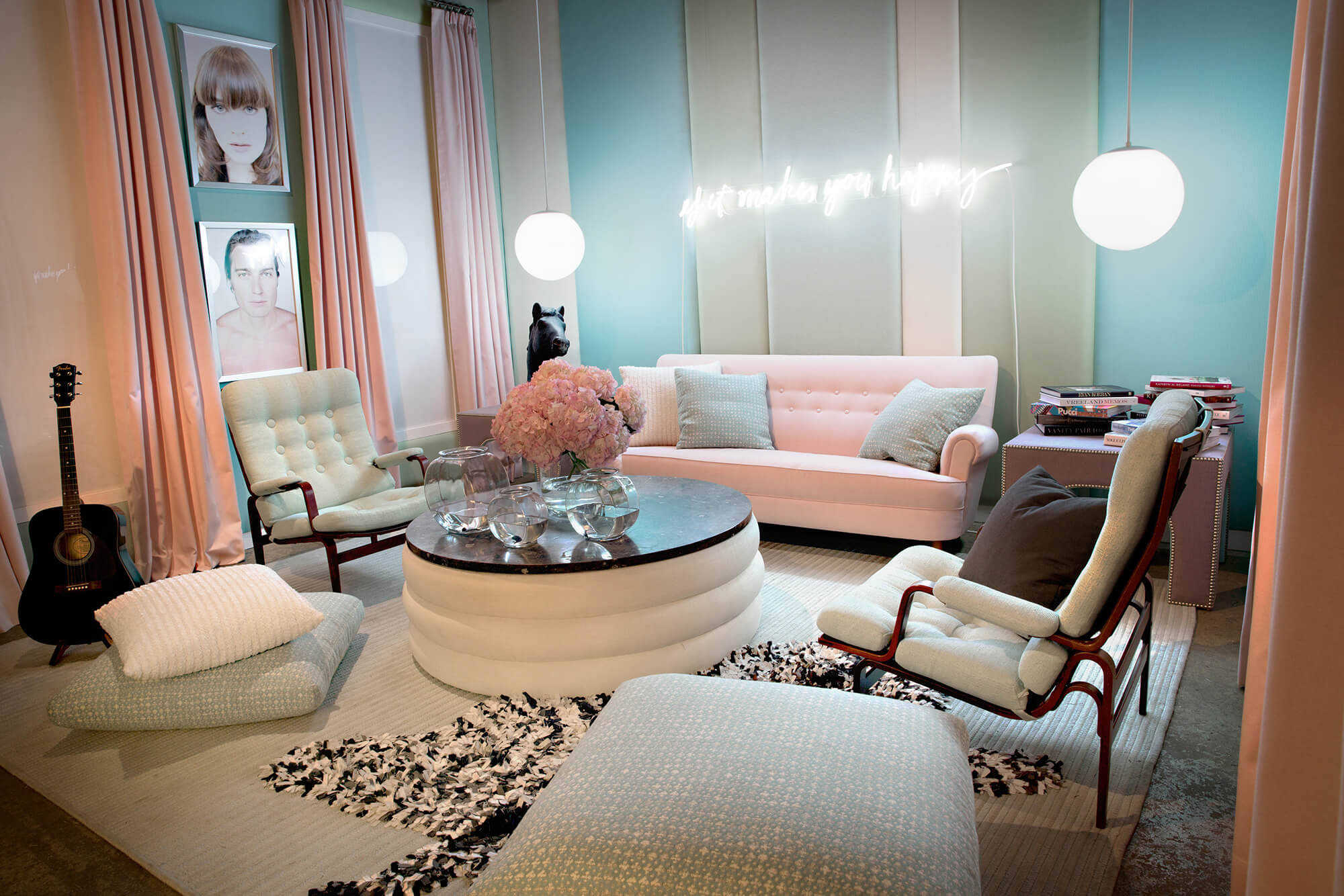 A white sofa gets a pop of color with teal and pink decorative throw pillows made using Sunbrella fabrics