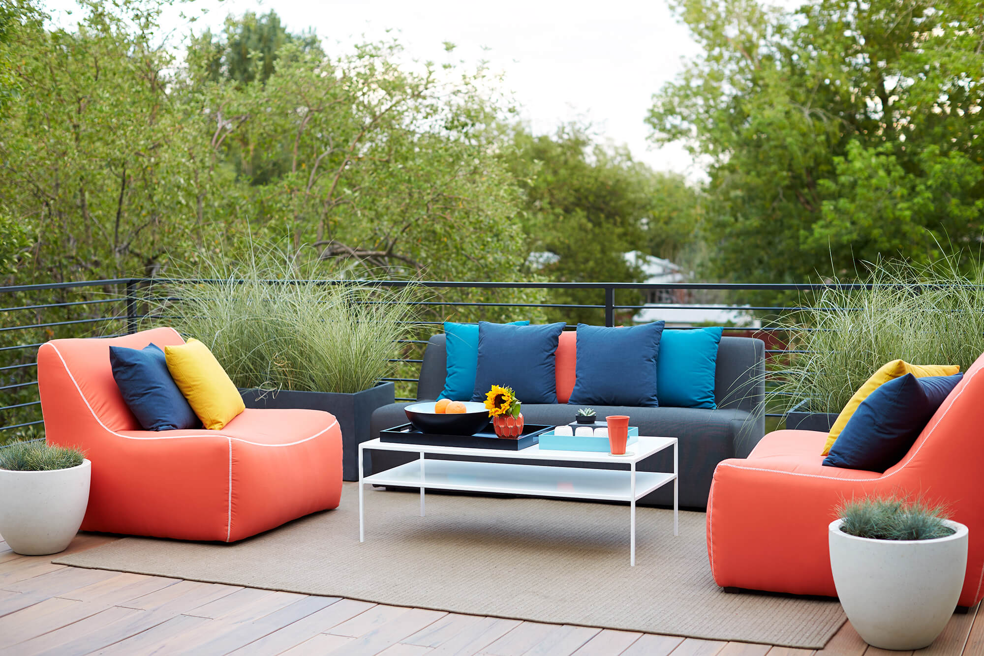Oversized outdoor furniture is upholstered in red, blue and yellow fabrics
