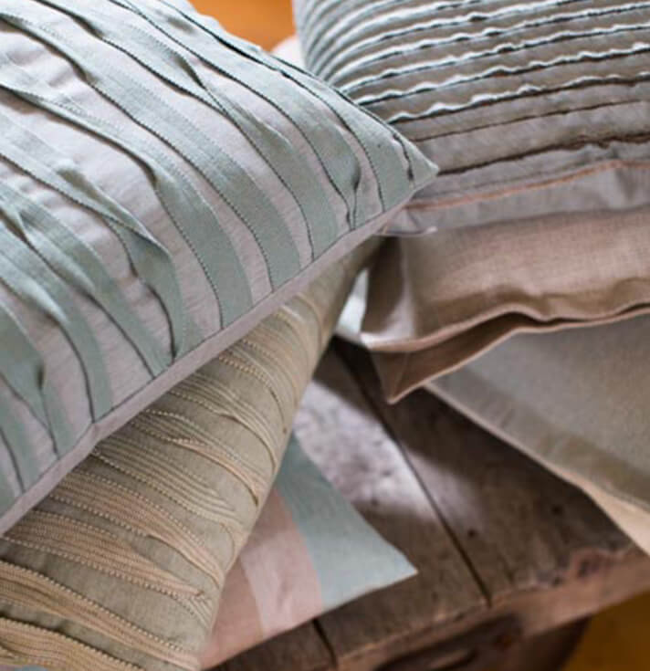 Pillows in pastel hues from the Sunbrella Performance Art collection