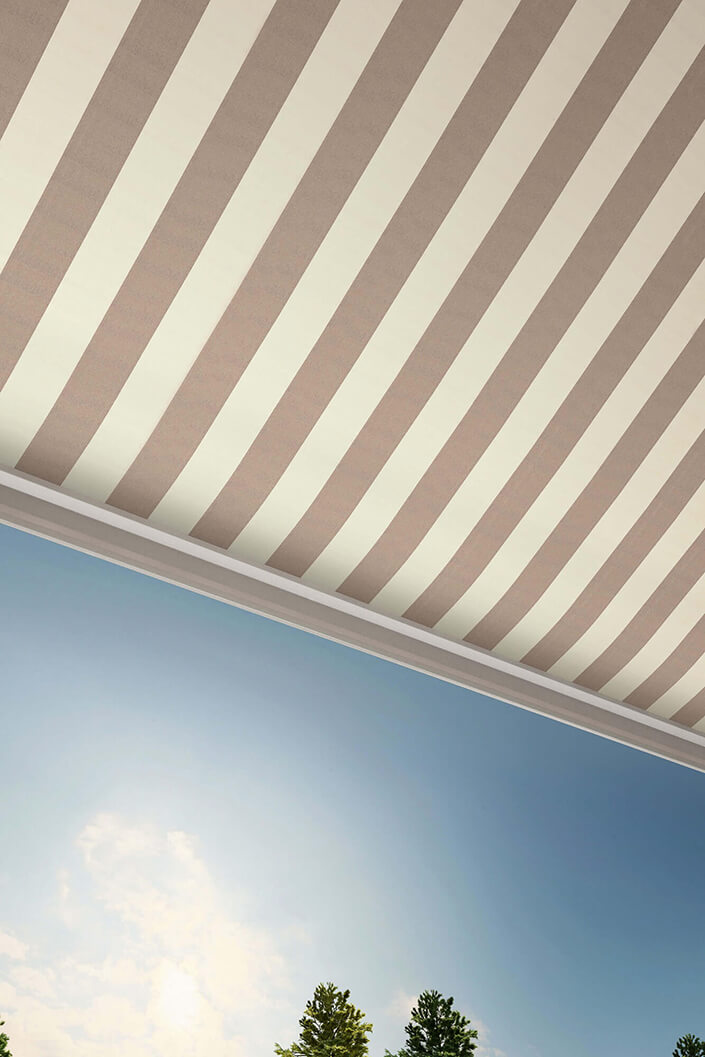 View of beige and white striped awning from the underside