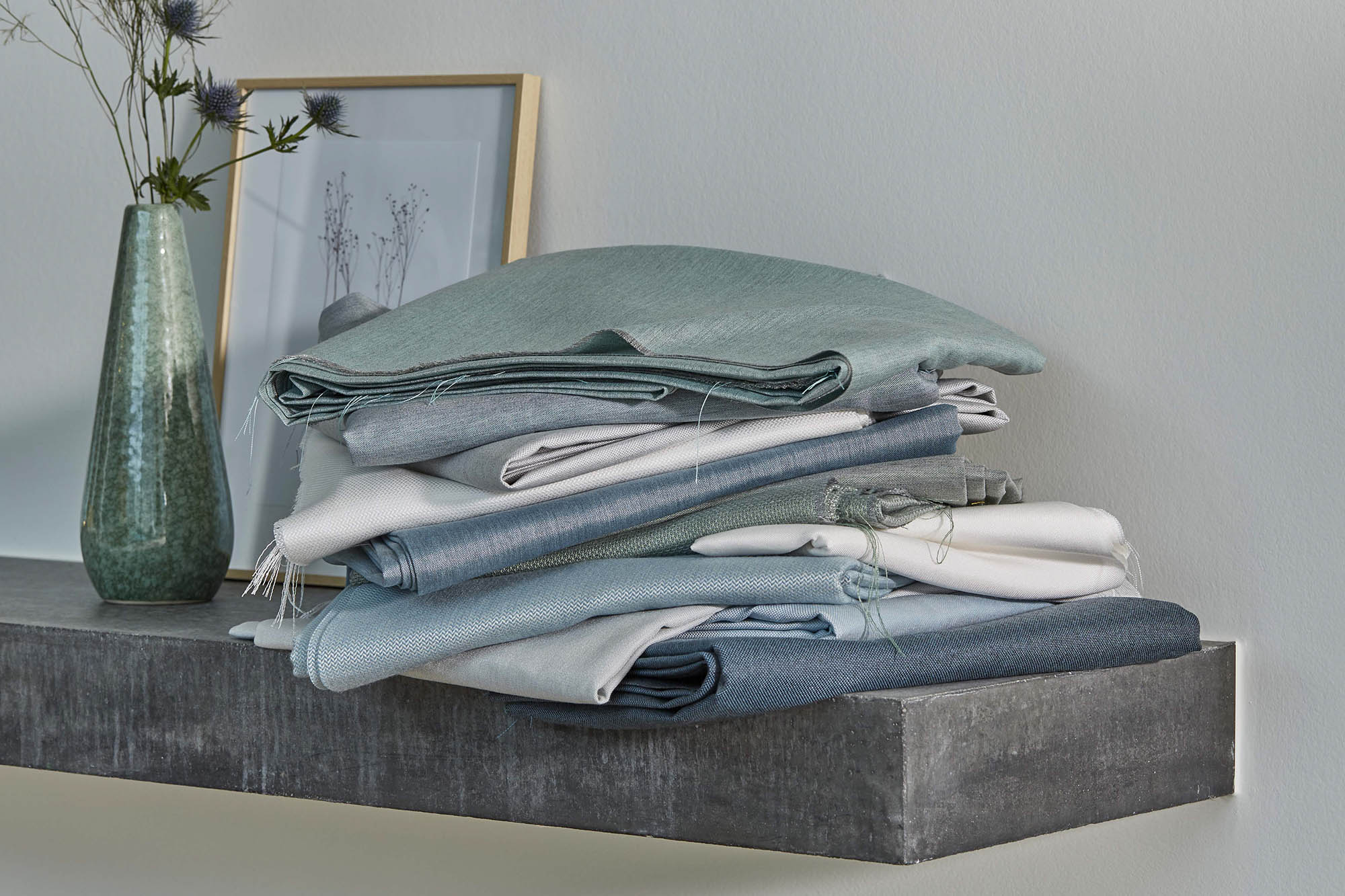 stack of folded sunbrella fabrics on shelf