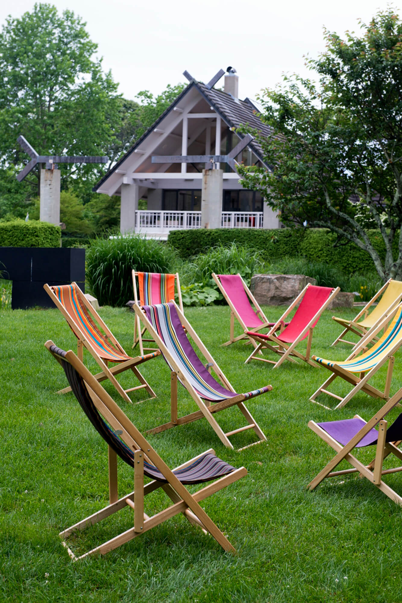 Brightly colored cabana chairs placed on the lawn
