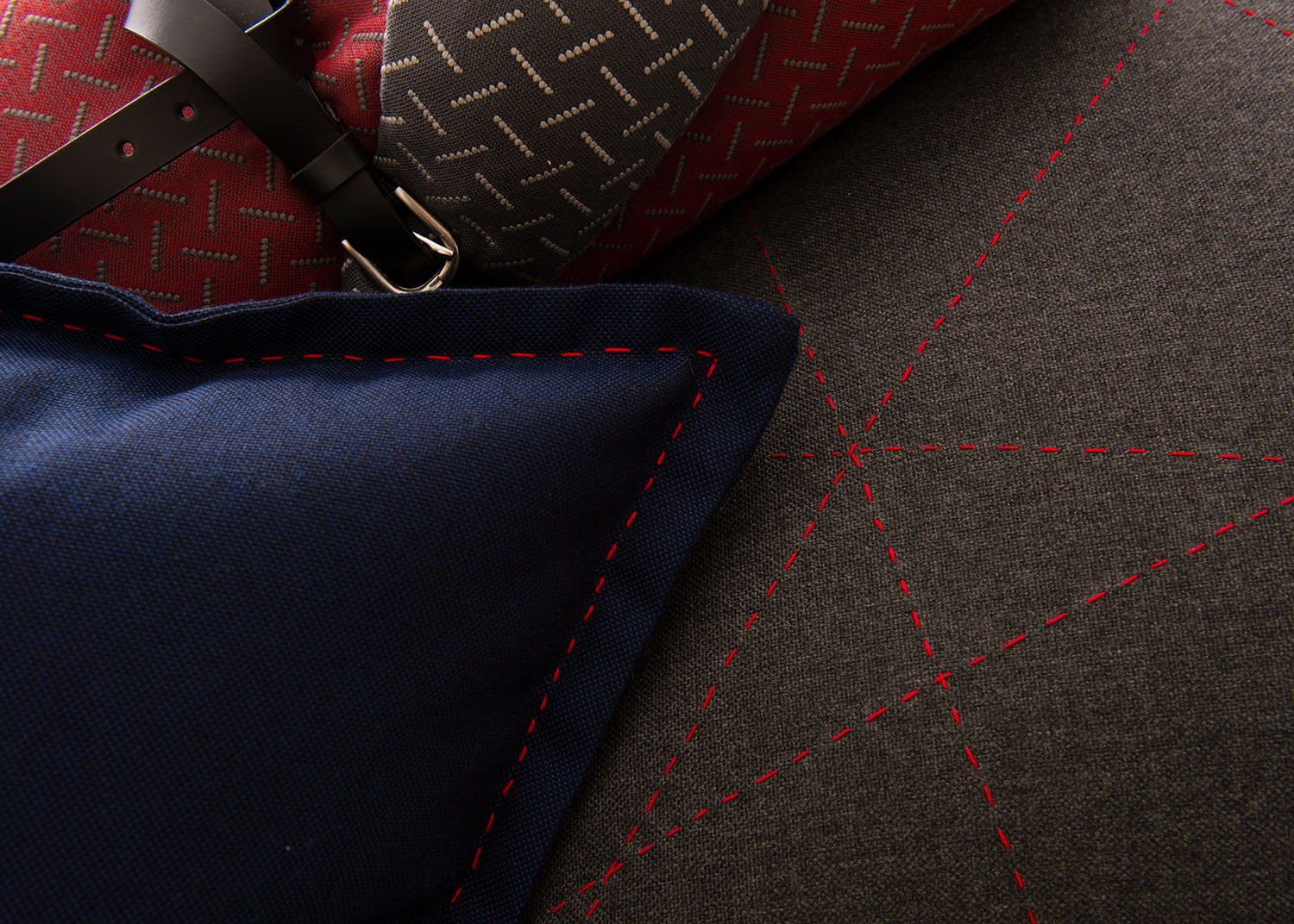 Close up of pillows with nautical pops of blue and red.