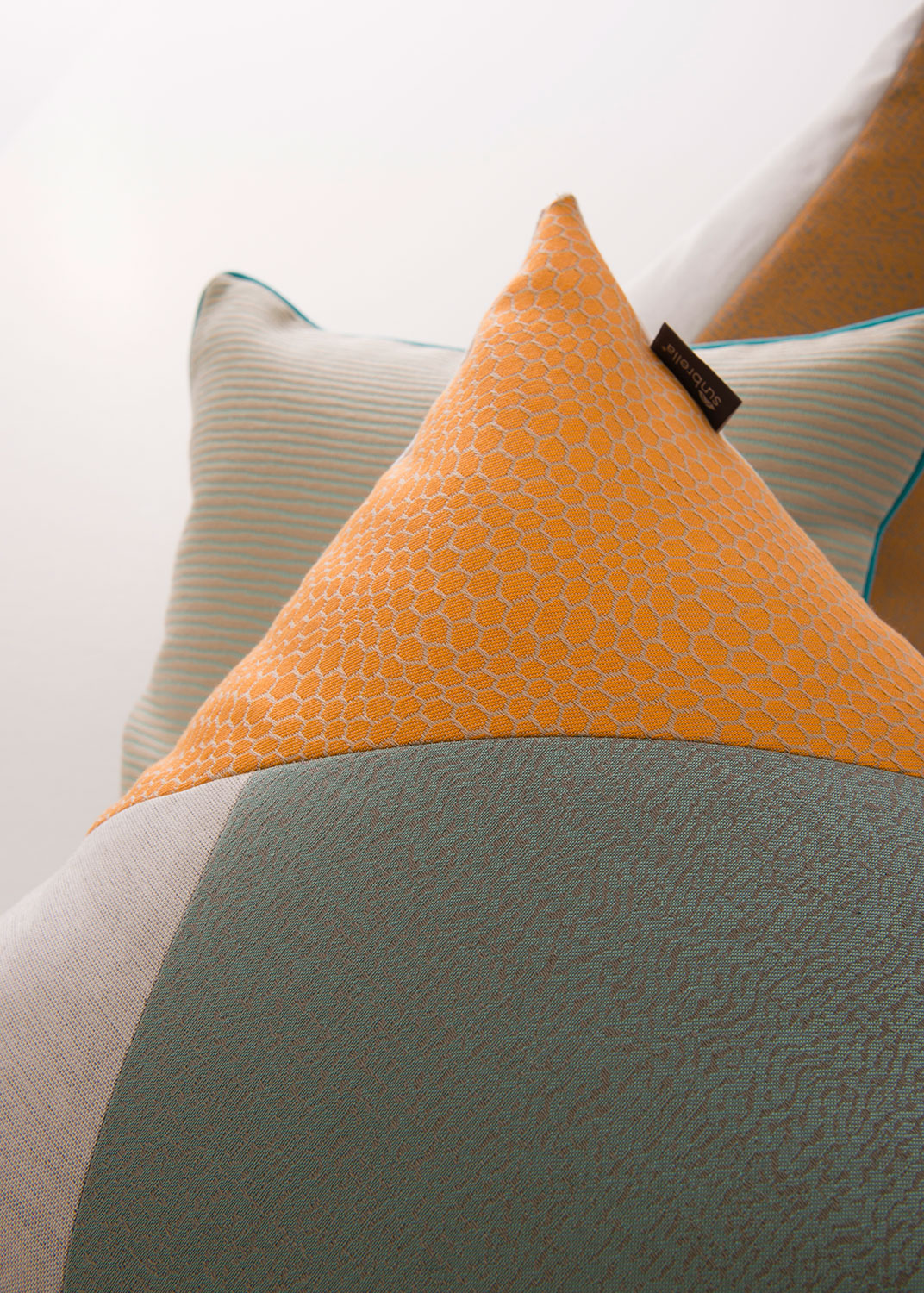 Different Sunbrella fabrics are sewn together for a unique geometric pattern.