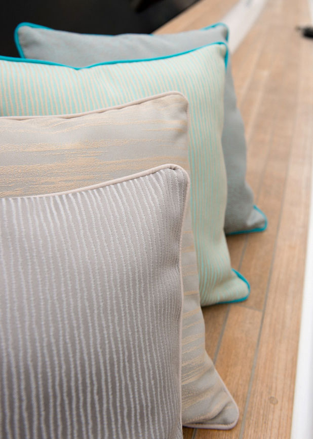 Pillows made using Sunbrella fabrics lined on a boat deck.