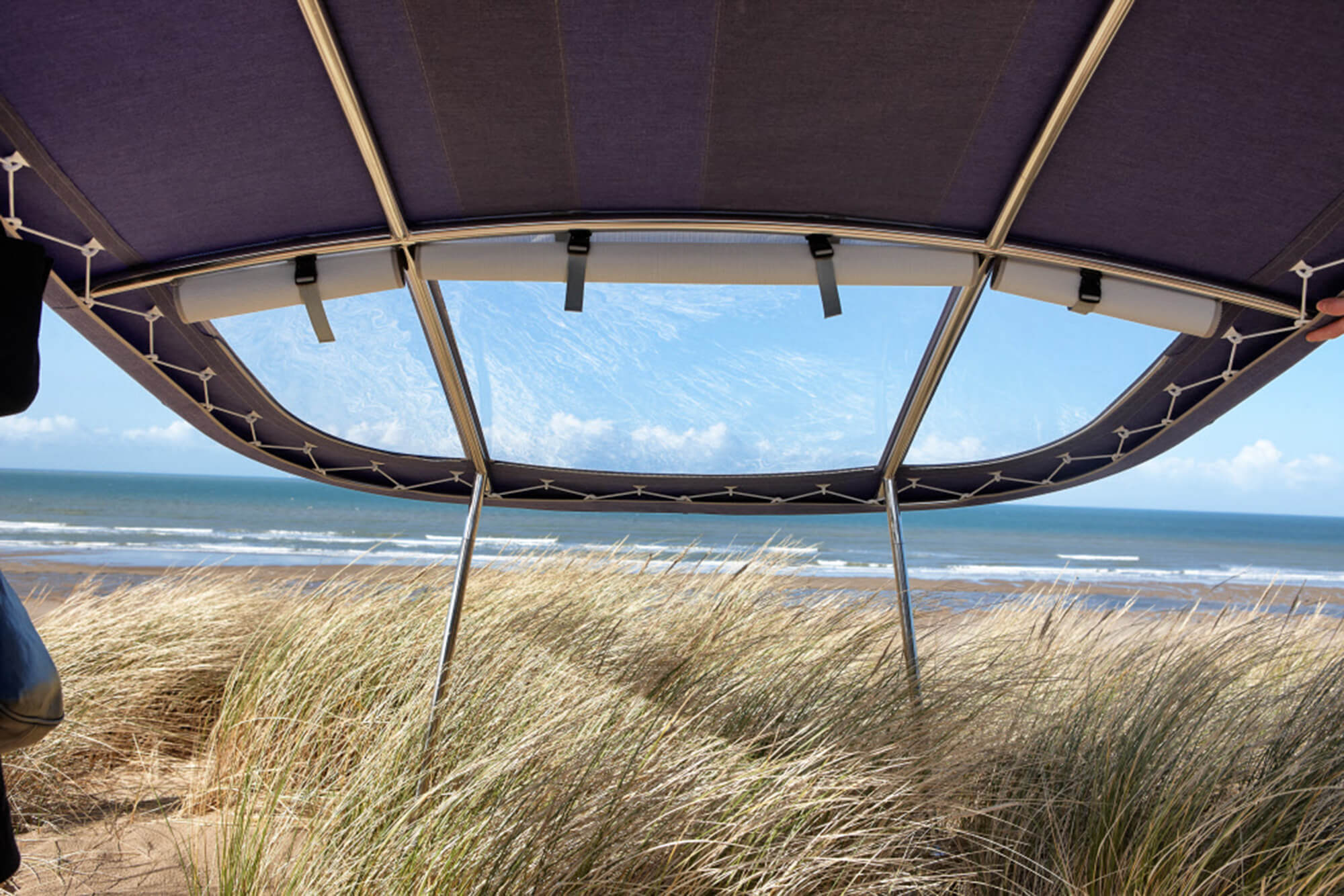 A Bimini made using Sunbrella fabric sits in the grass