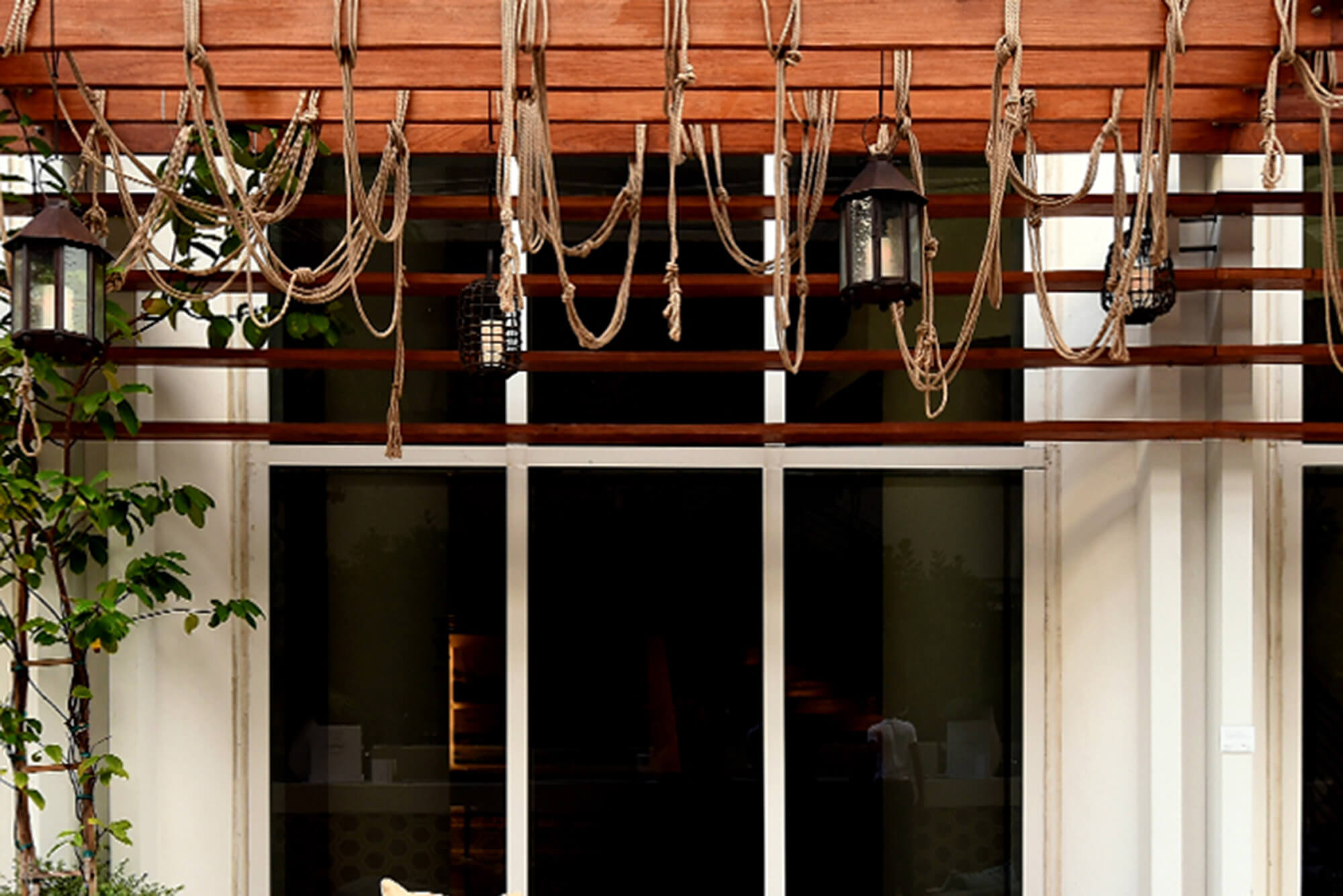 An outdoor seating area is decorated above with Sunbrella Rope