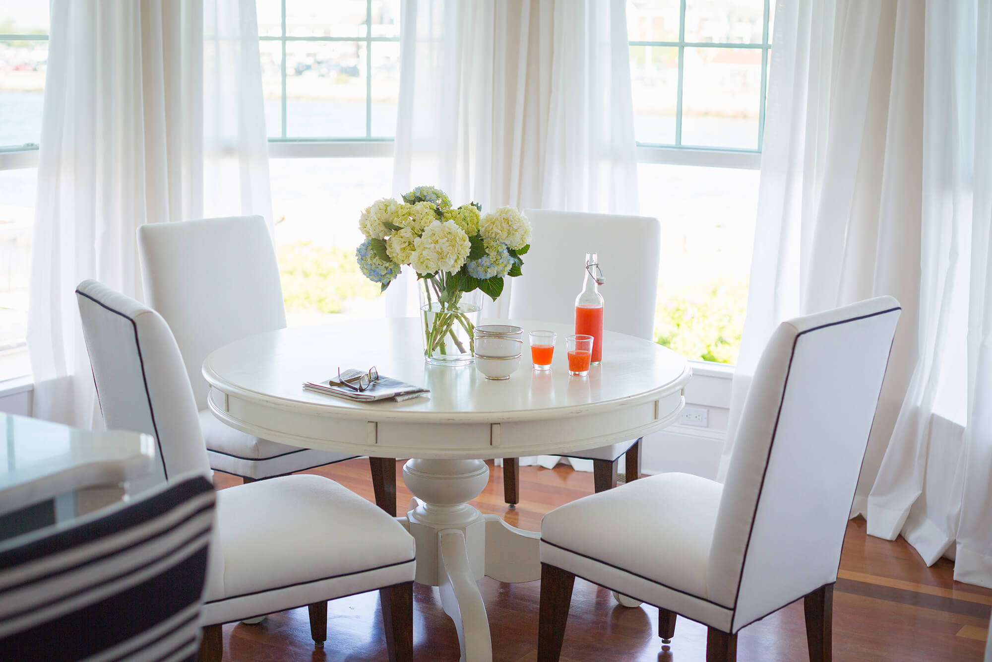 Flowing Sunbrella Sheer drapery add romance to a dining room
