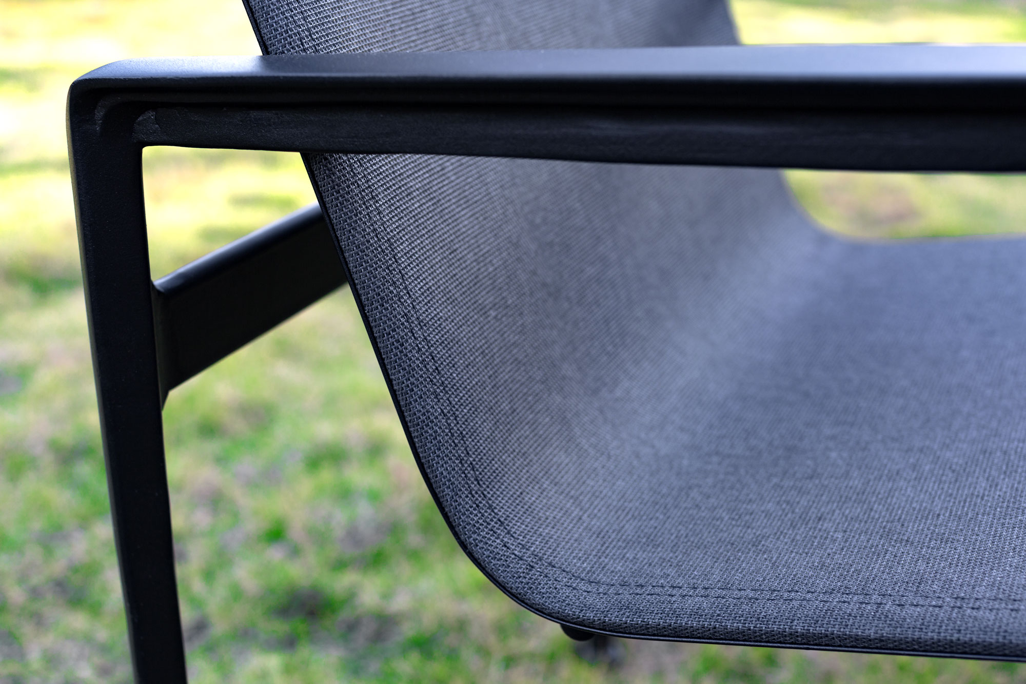 Highlight the fabrication of an outdoor sling chair made using Sunbrella Sling.