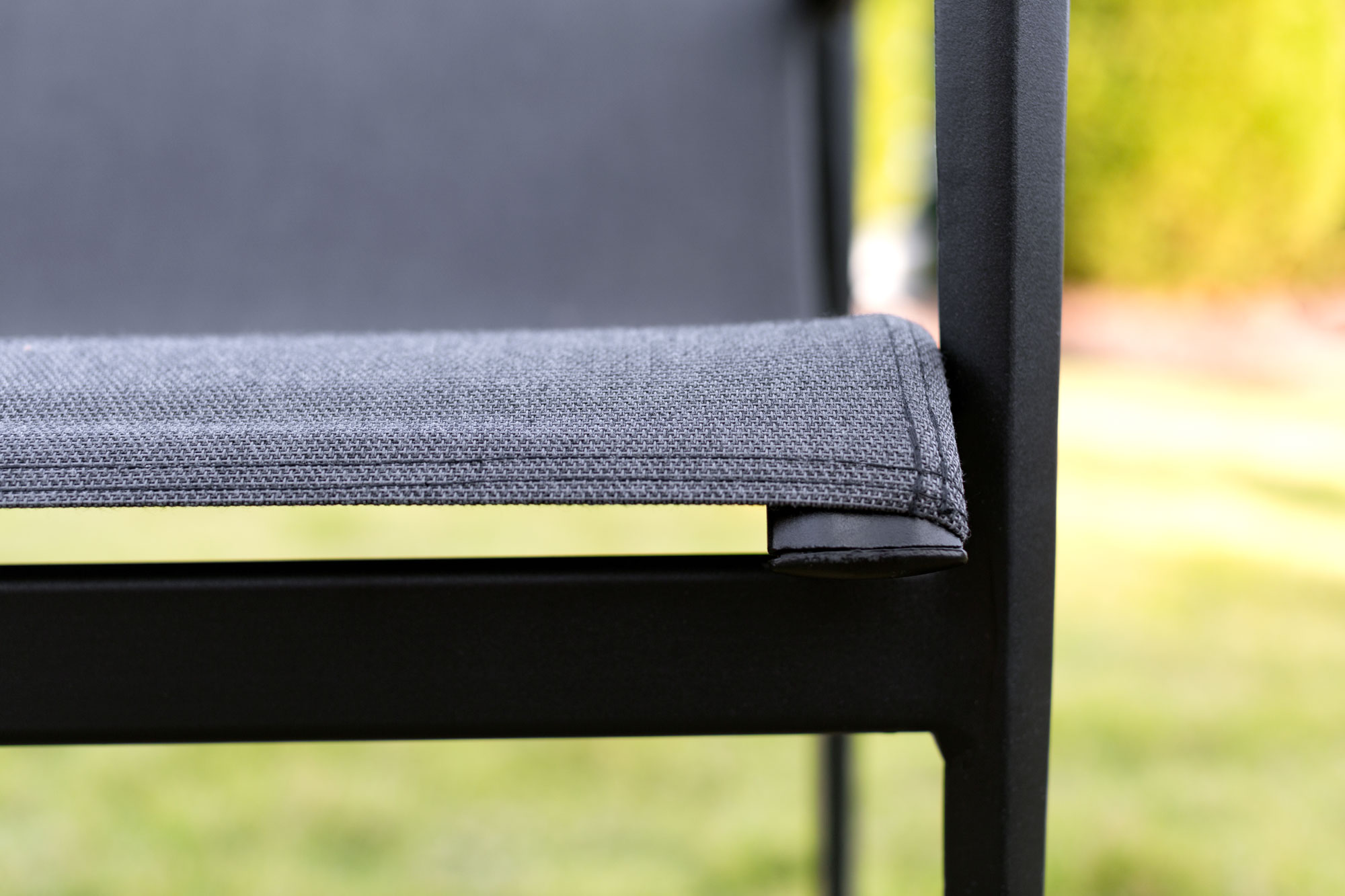 Detailing of Sunbrella Sling fabric made into an outdoor chair.