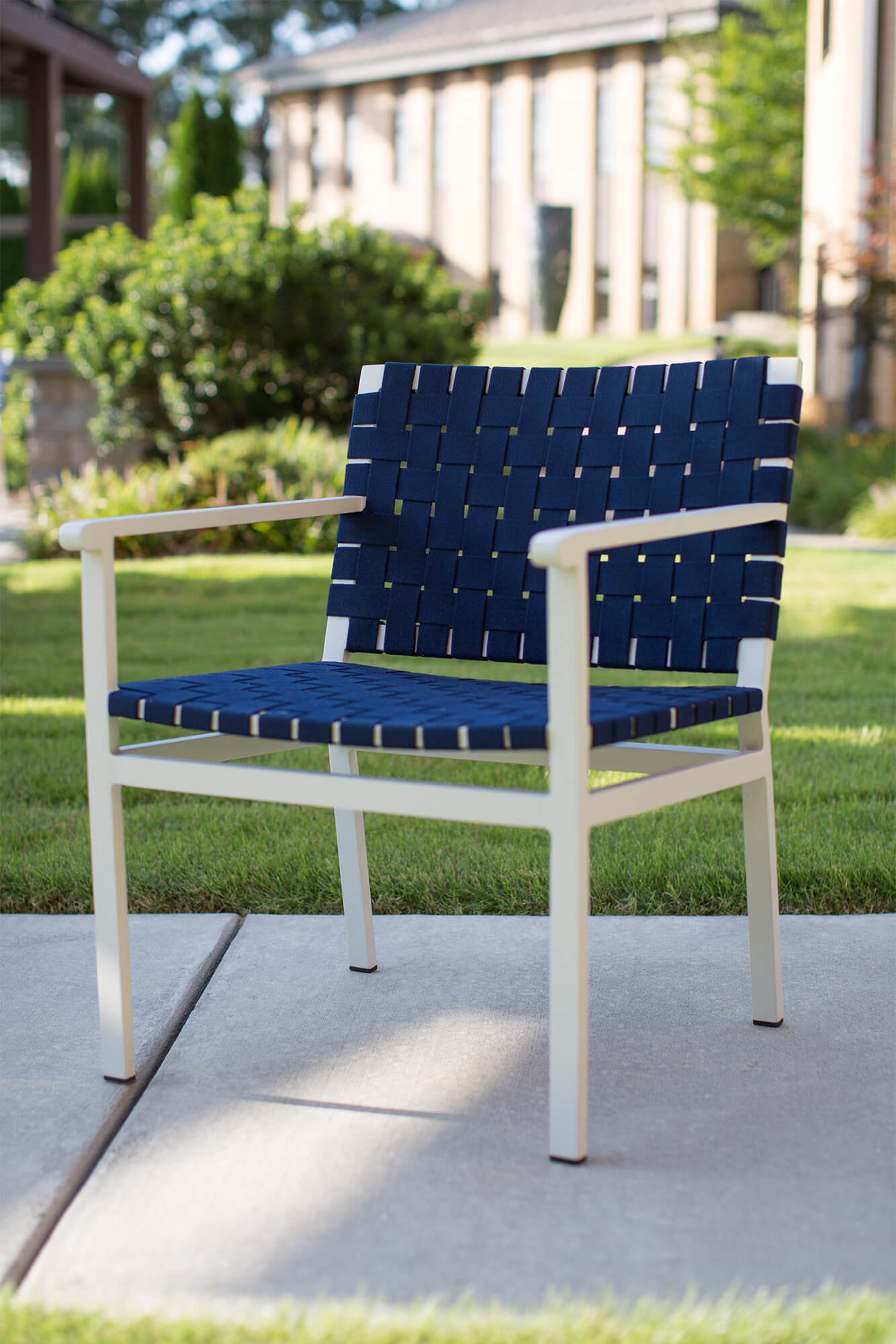 An outdoor chair made with navy blue Sunbrella Strap