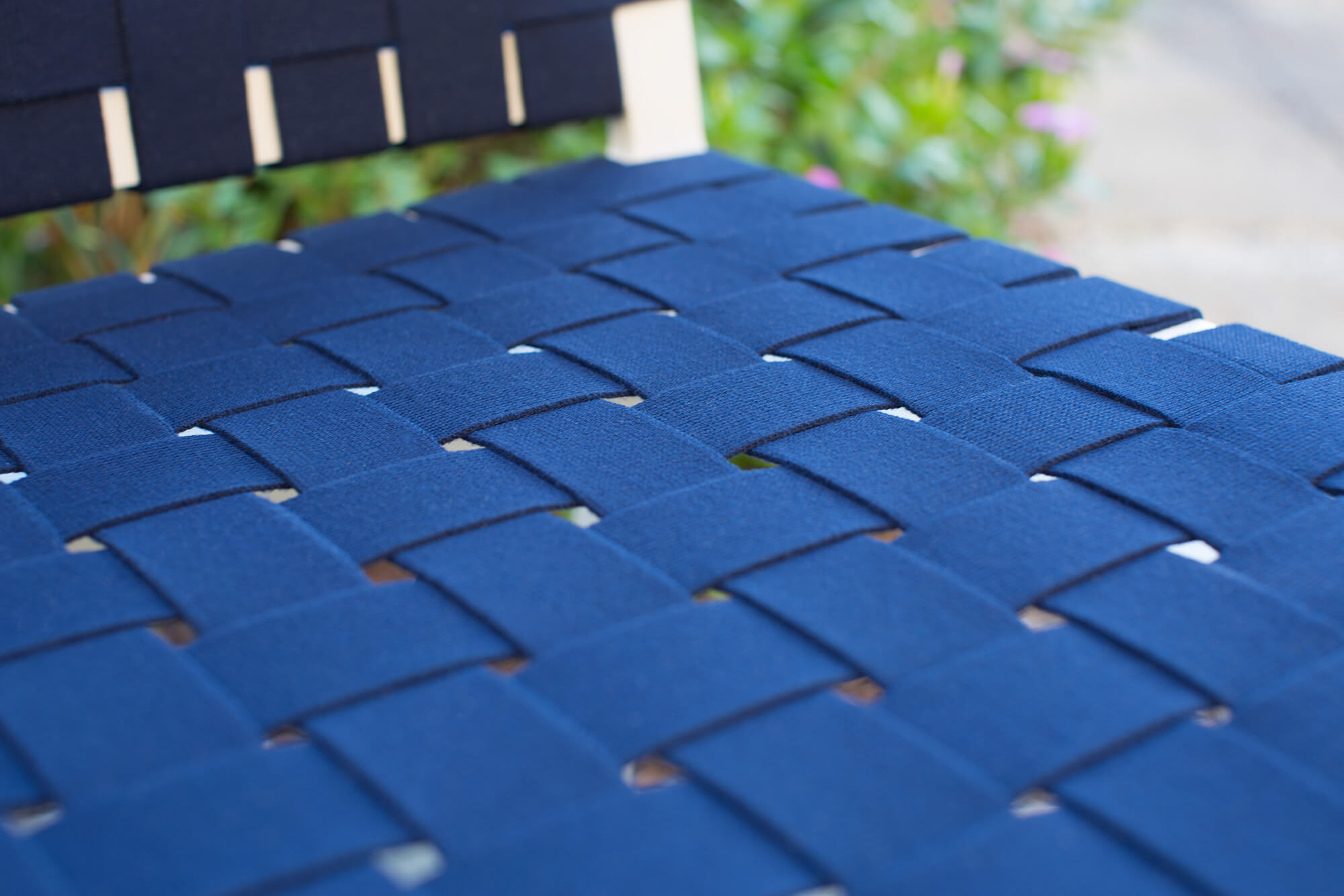 Close up detail of a navy blue Sunbrella Strap seat