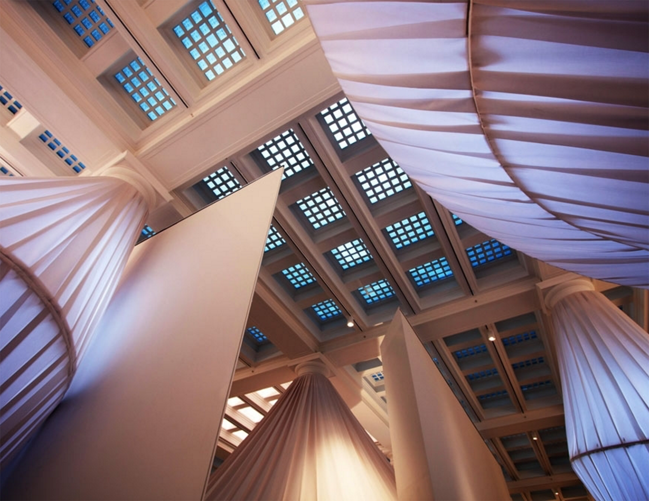 Shot looking up at reOrder art installation at the Brooklyn Museum featuring Sunbrella fabrics