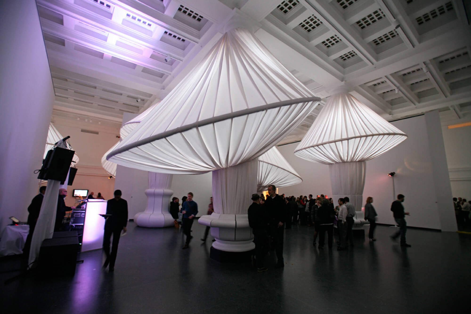 People admiring the reOrder exhibit featuring Sunbrella fabrics at the Brooklyn Museum