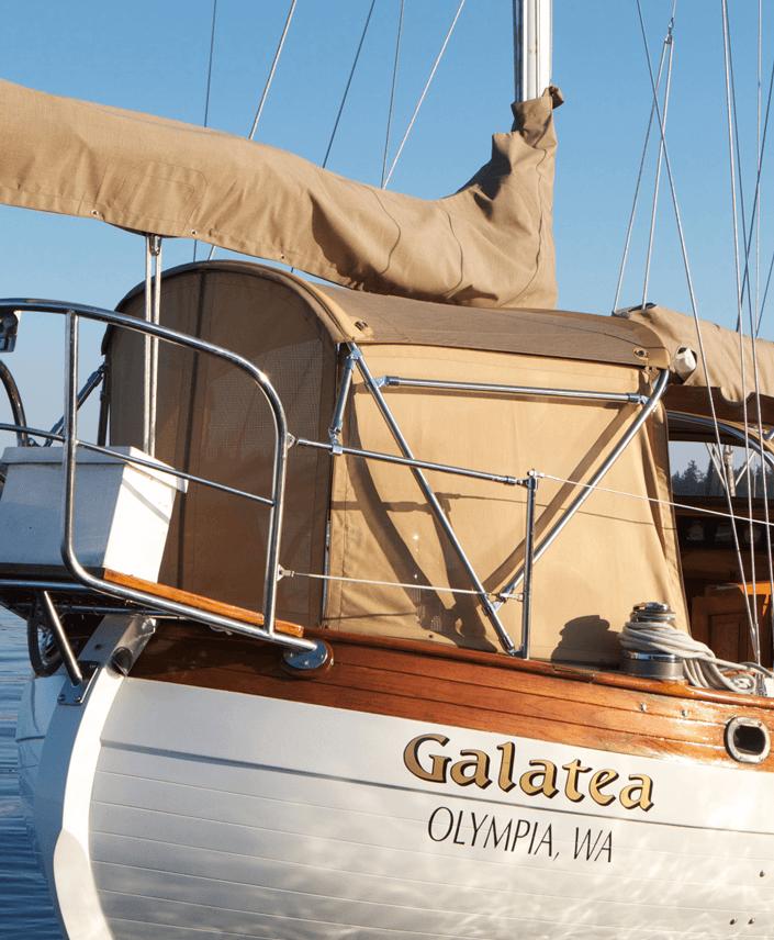 Galatea sailboat featuring sailcover and enclosure made using Sunbrella fabrics