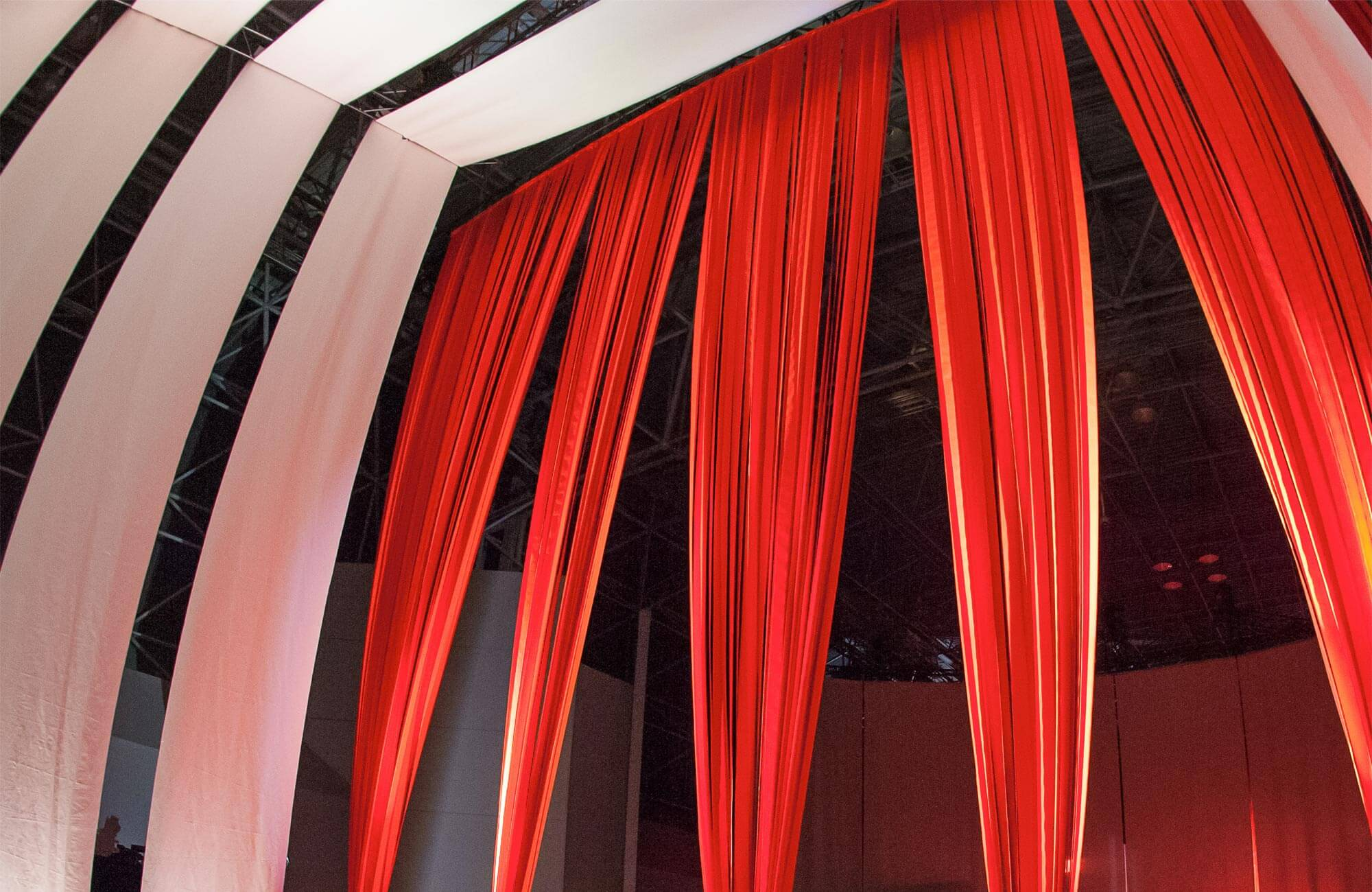 Looking up at the Hall of Fame curtain made using strips of Sunbrella Orange fabric.
