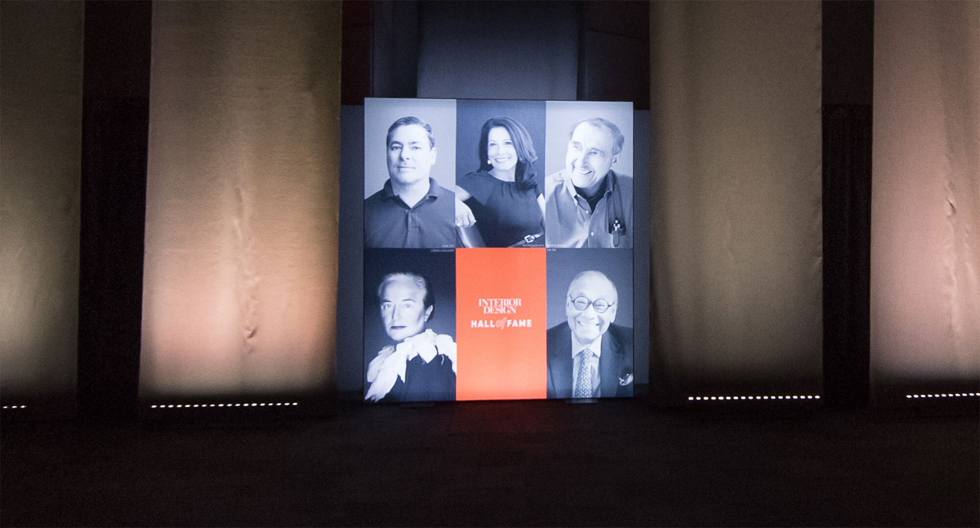 View of the presentation screen featuring Interior Design's Hall of Fame inductees.