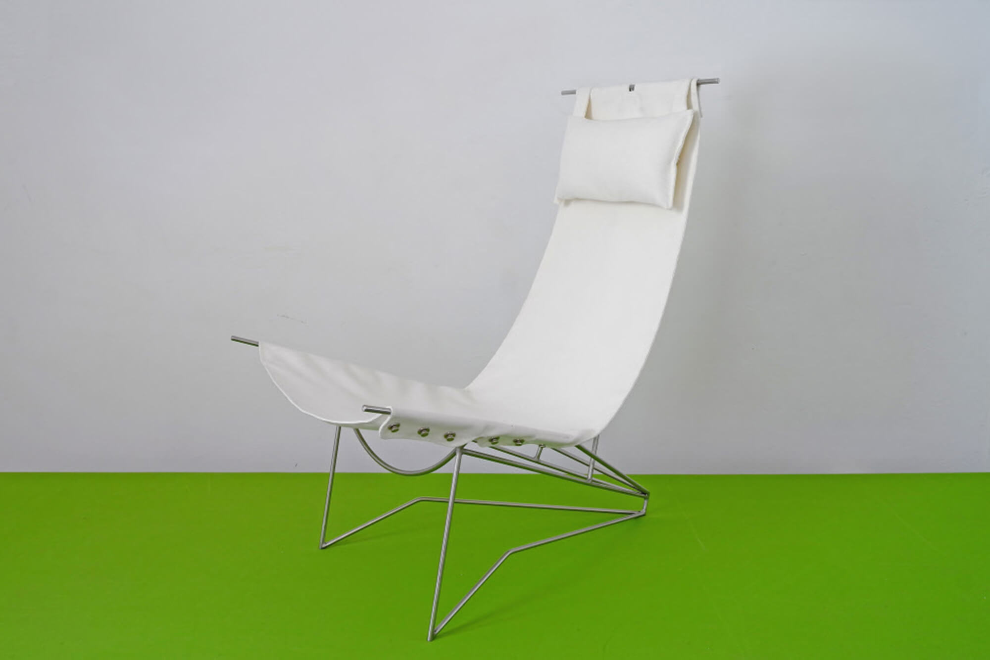 A chair featuring white Sunbrella fabrics with metal body
