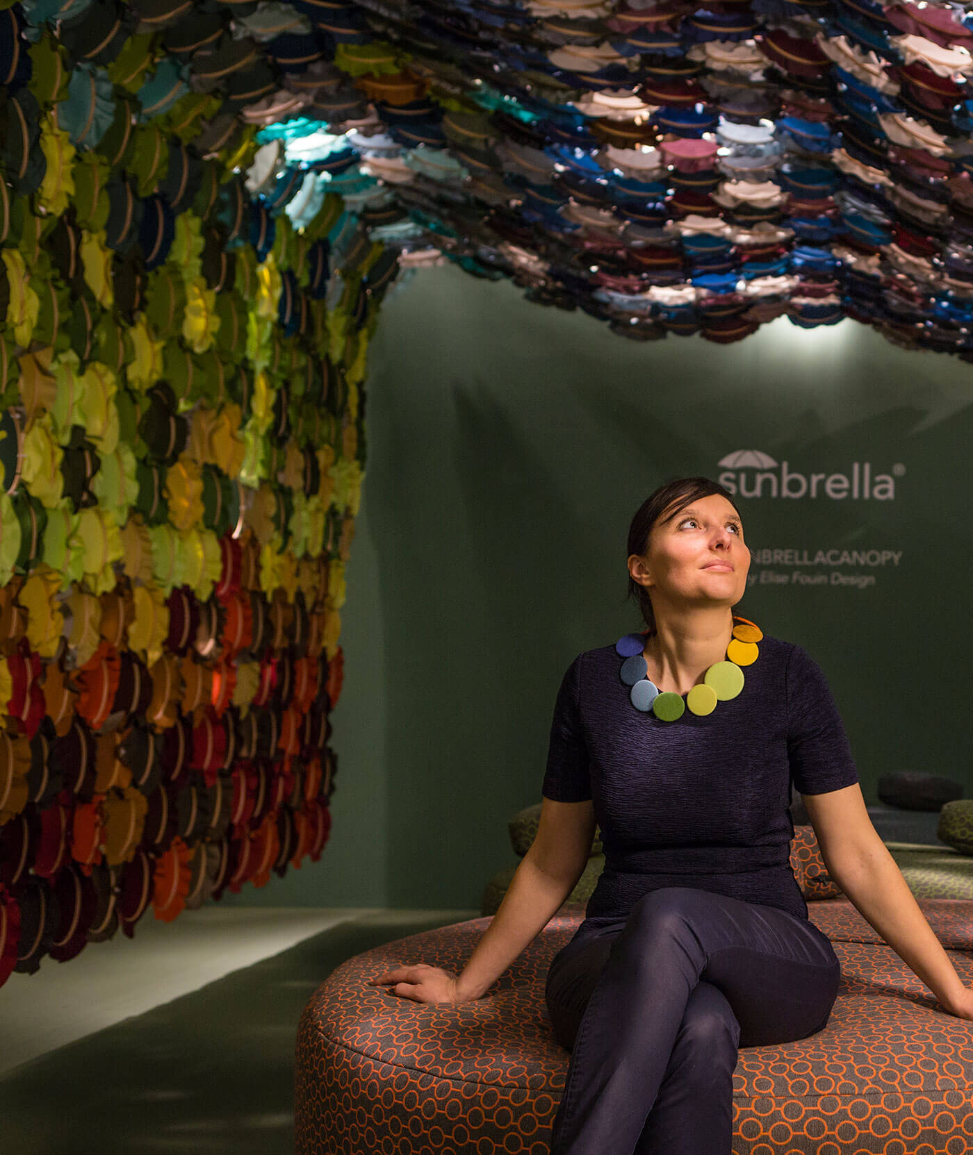 Art installation featuring bright colors of Sunbrella fabrics in interlocking embroidery hoops.