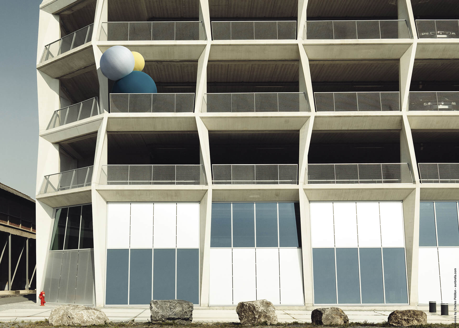 The Sunbrella Connexions balloons made using Sunbrella upholstery fabrics sit on a balcony.