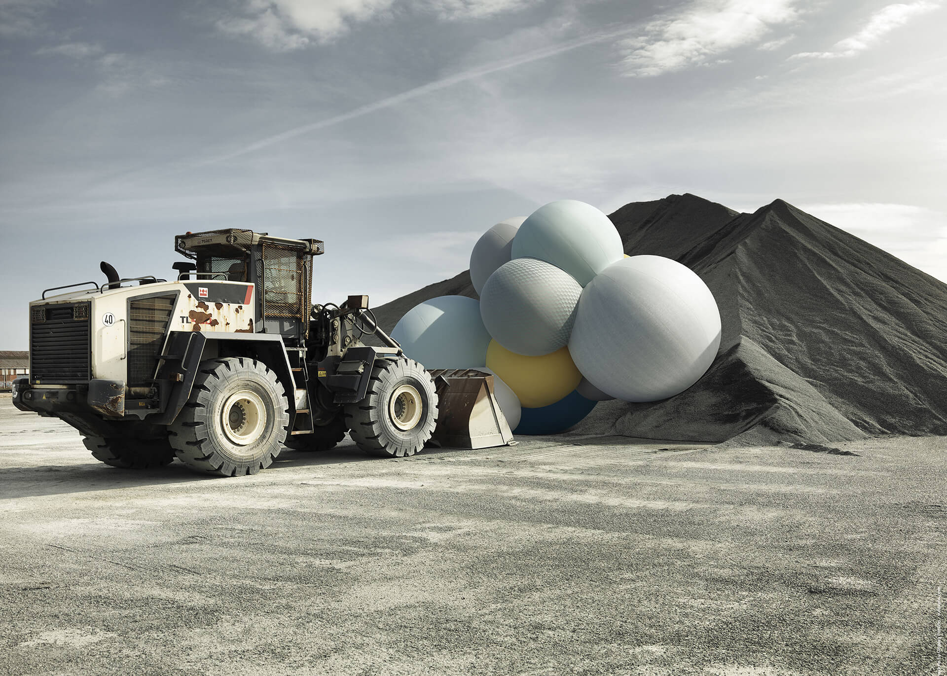 A bulldozer pushes the Sunbrella Connexion balloons by artist Charles Petillon.