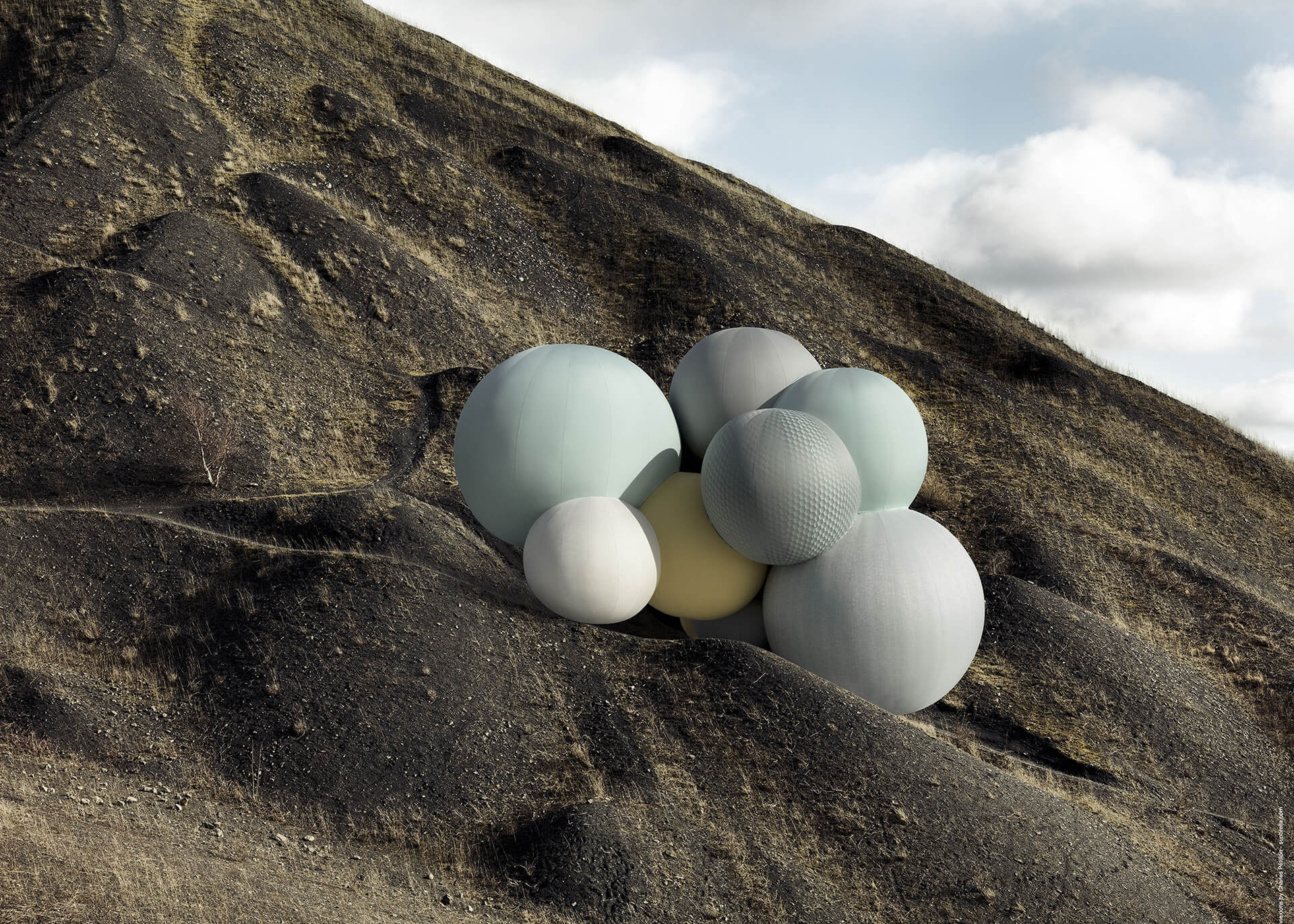 The Sunbrella Connexions Balloons featuring Sunbrella upholstery fabrics sit on a rock cliff.