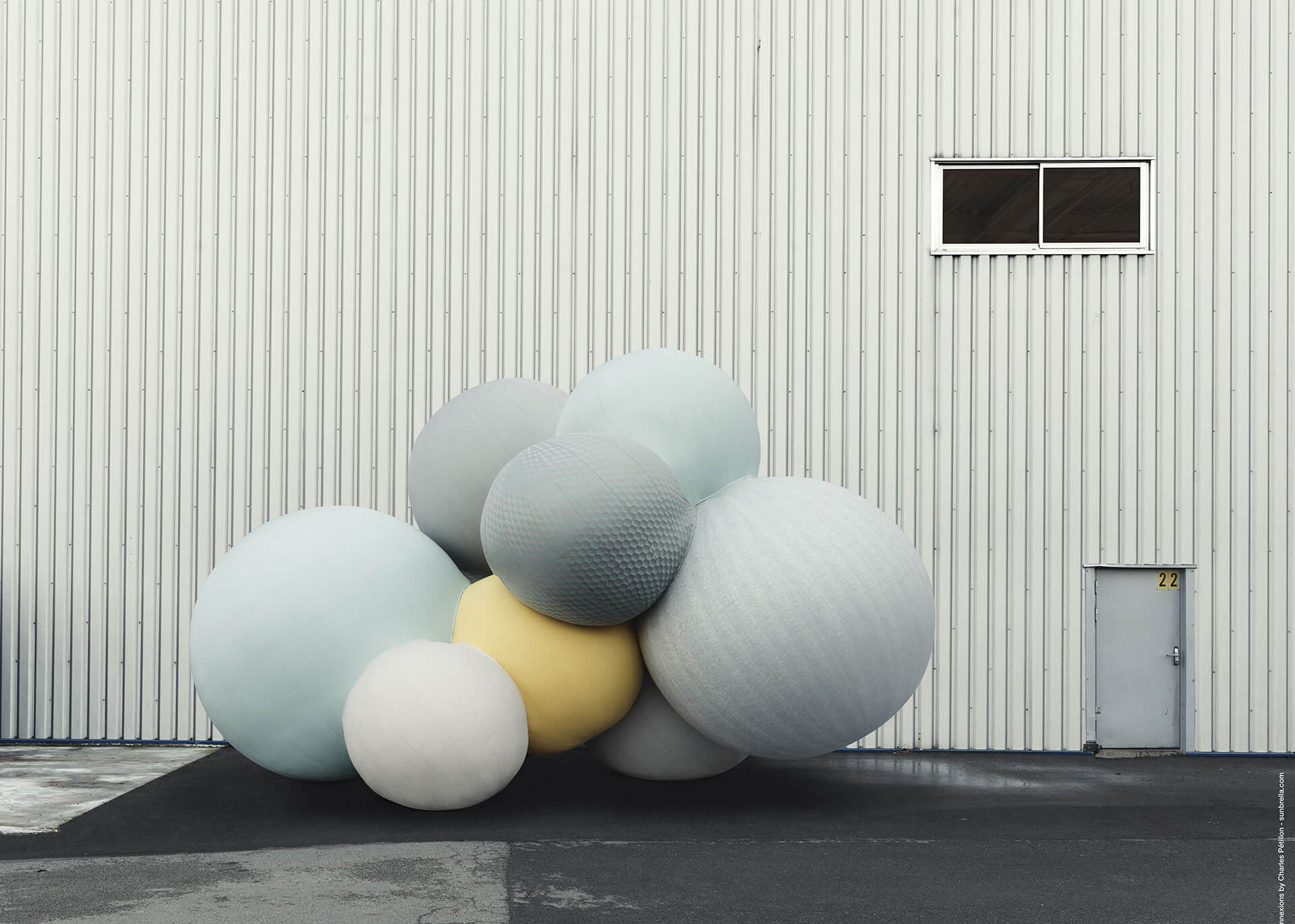 Sunbrella Connexions by Charles Petillon balloons sitting in front of a warehouse.