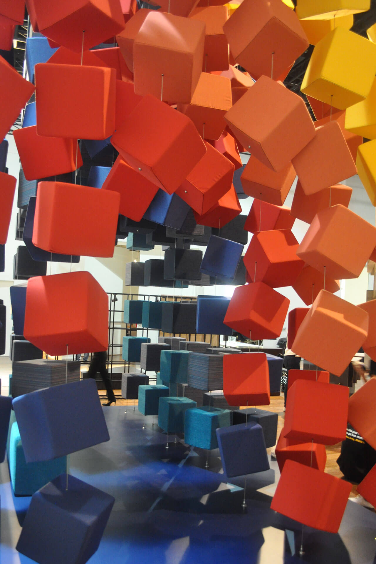 The Sunbrella Spectrum cubes create a tunnel for visitors to walk through and experience the fabrics.