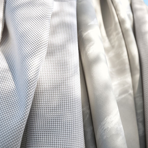 Close up of white and beige Sunbrella fabrics.