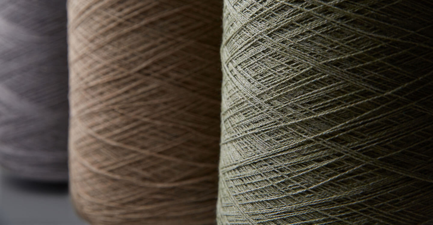 Closeup shot of recycled Sunbrella Renaissance yarns wound on a spool