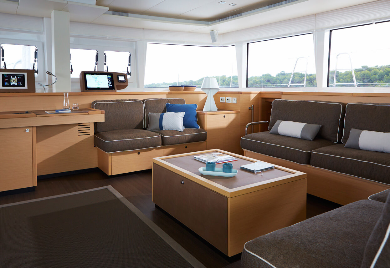 the cabin of a catamaran boat featuring blue cushions made using sunbrella fabrics