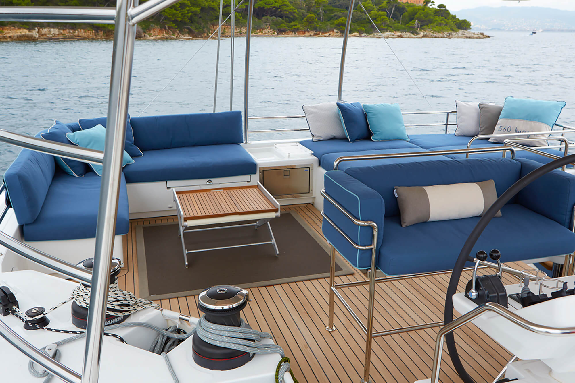 Boat seat cushions on the deck covered in blue Sunbrella upholstery fabrics