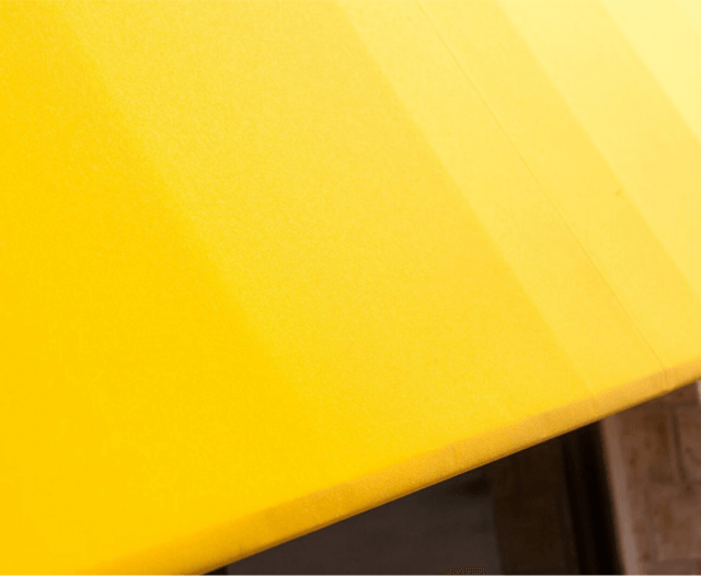 Close up detail of fixed frame awning with yellow Sunbrella Clarity fabric