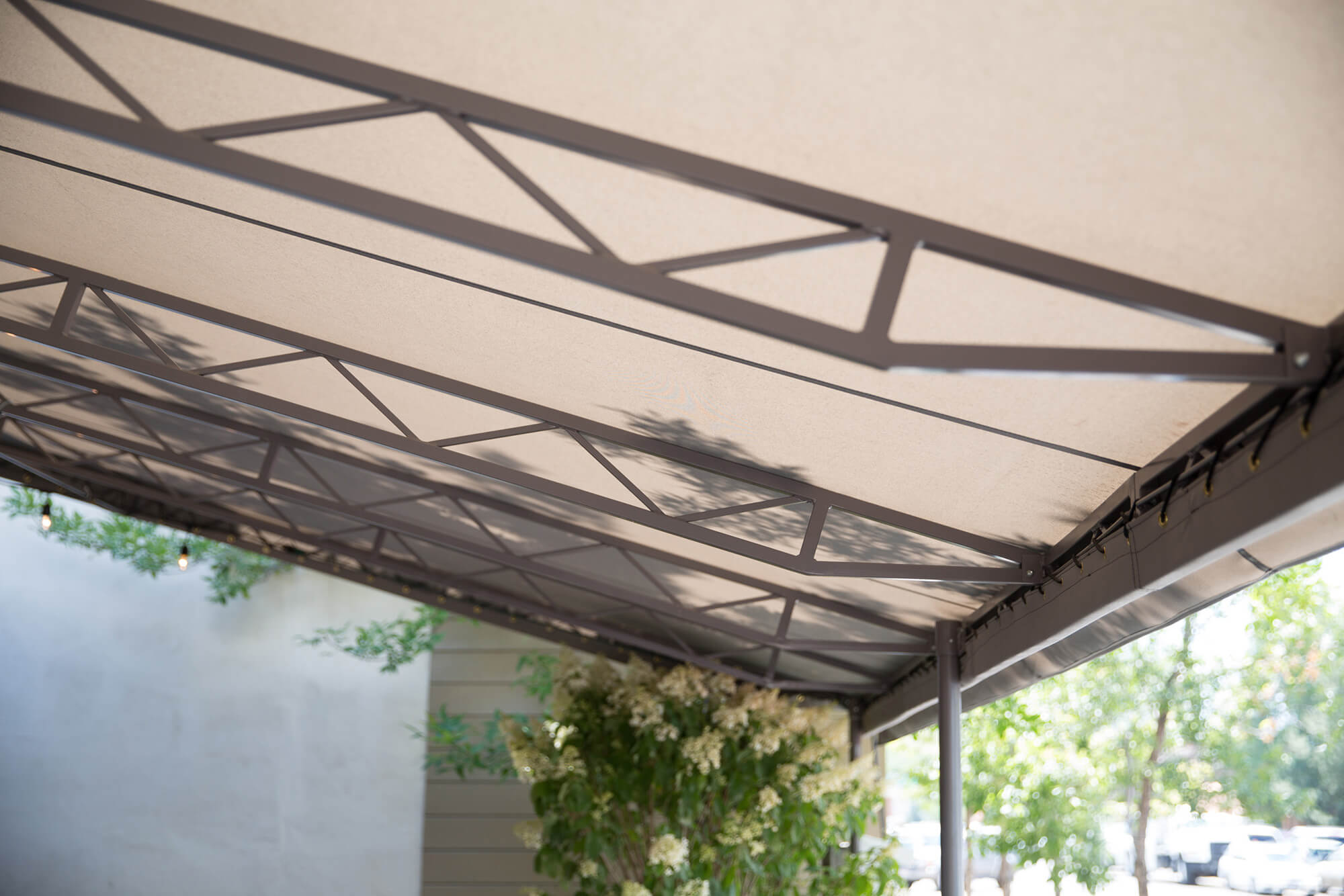 Detail of underneath fixed awning with beige Sunbrella fabric