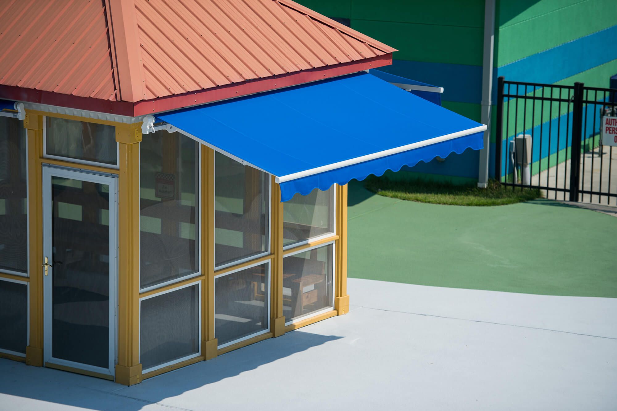 Extended retractable awning with blue Sunbrella fabric