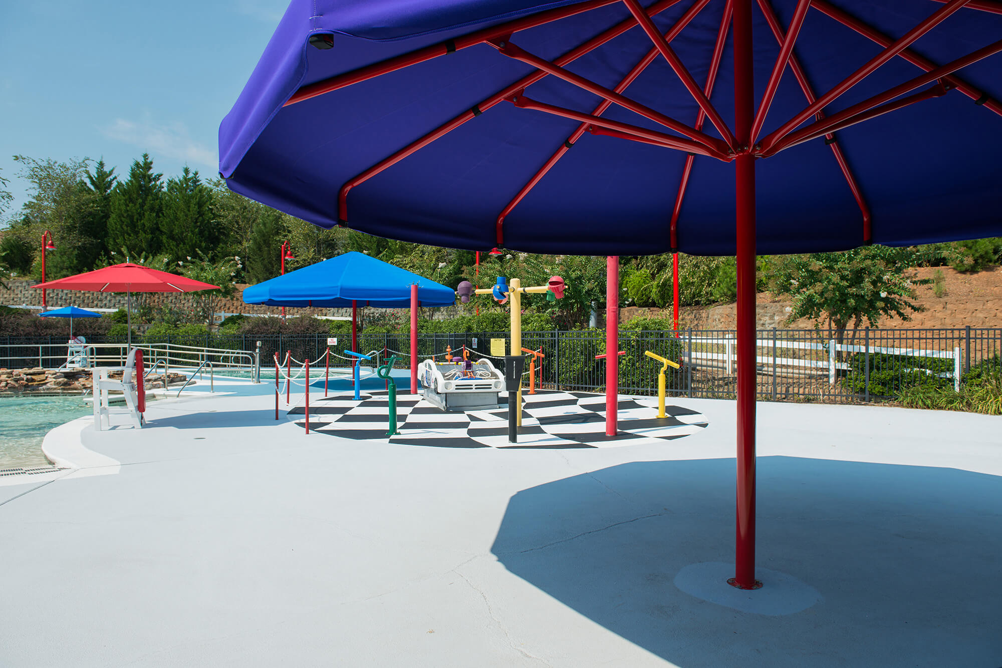 Colorful fixed umbrellas at children's waterpark