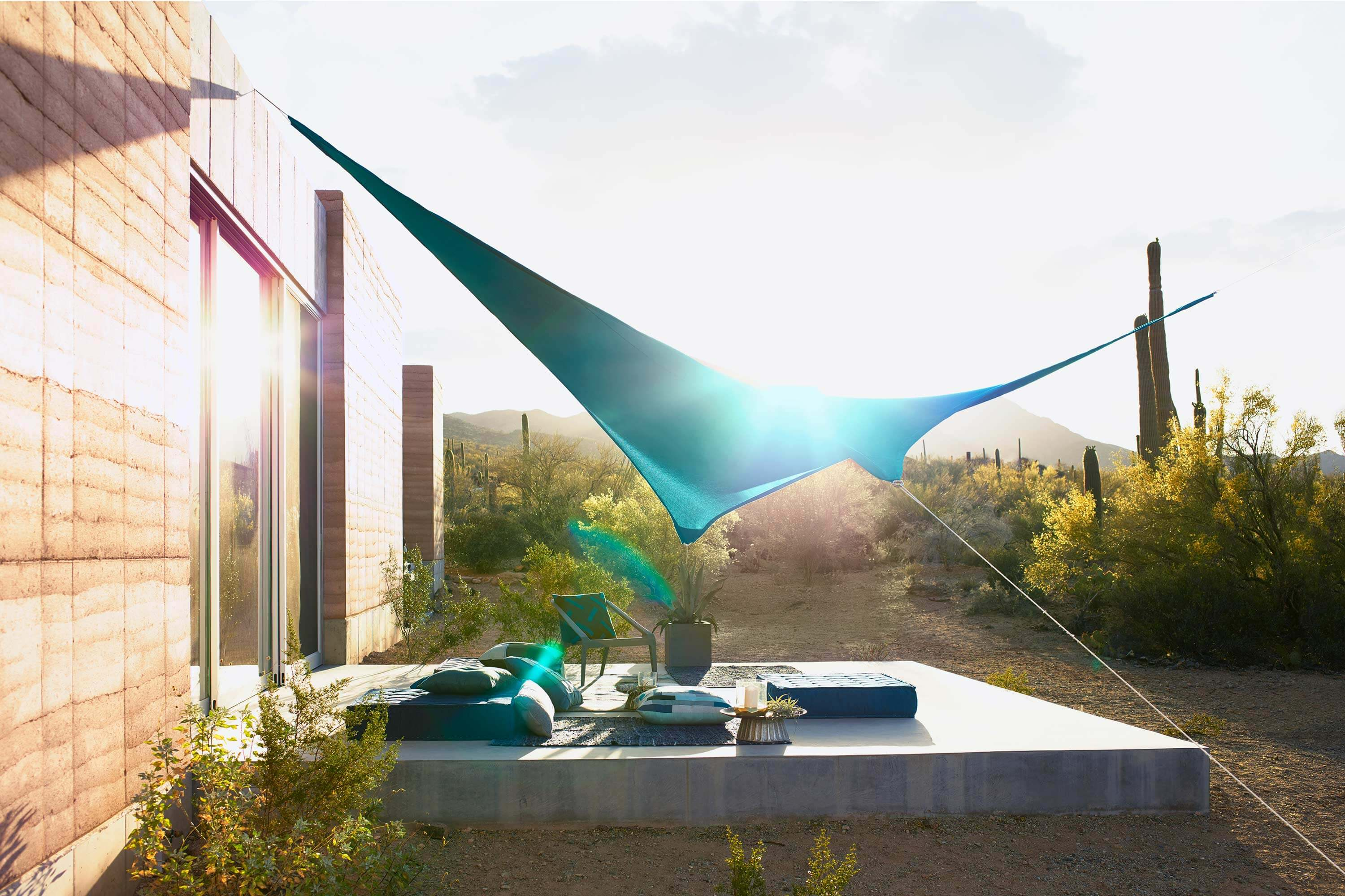 Merveilleux Outdoor Patio In The Desert Covered With Shade Sail Made Using Teal  Sunbrella Contour Fabric