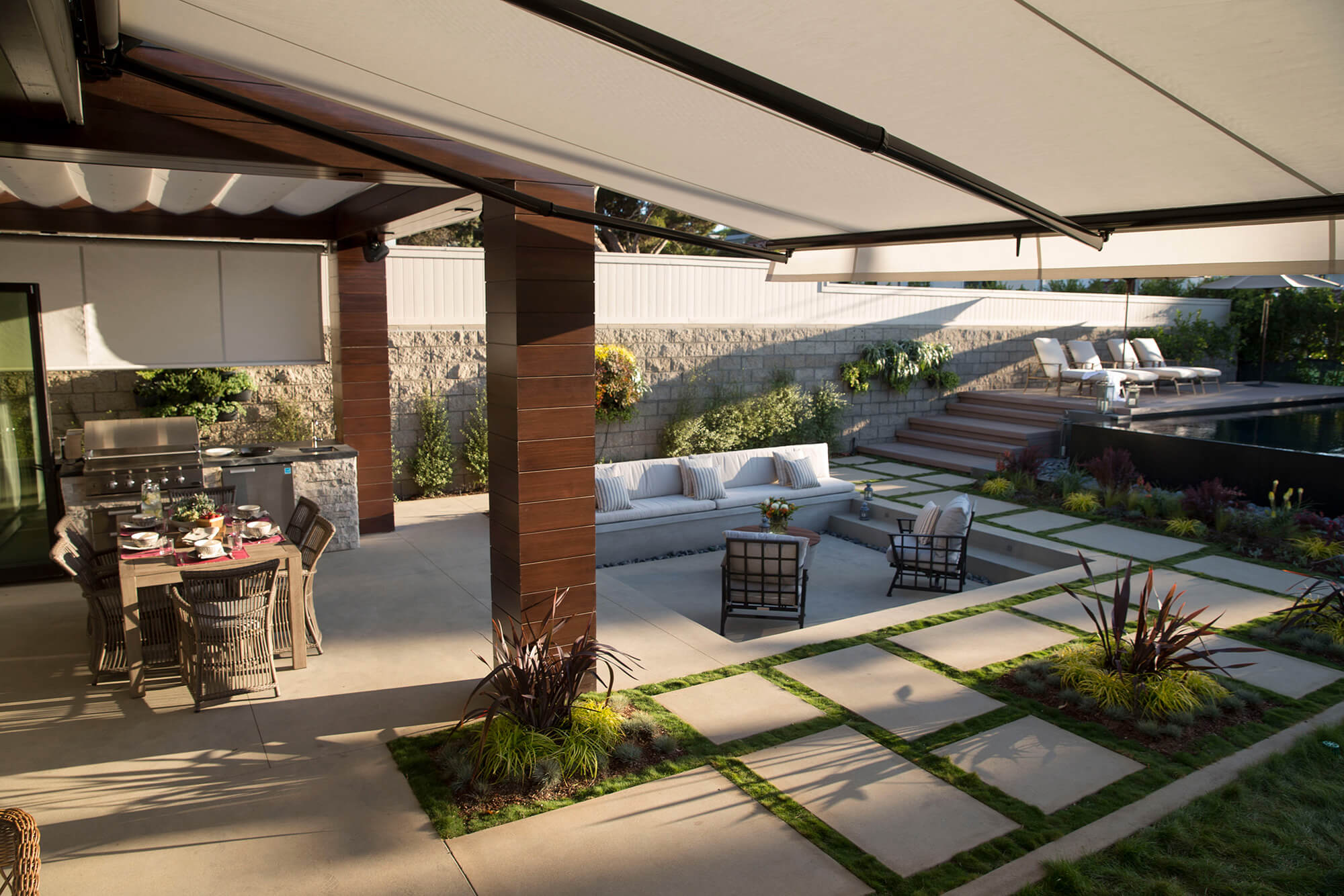 Patio Underneath A Retractable Awning Made With Silver Sunbrella Fabric