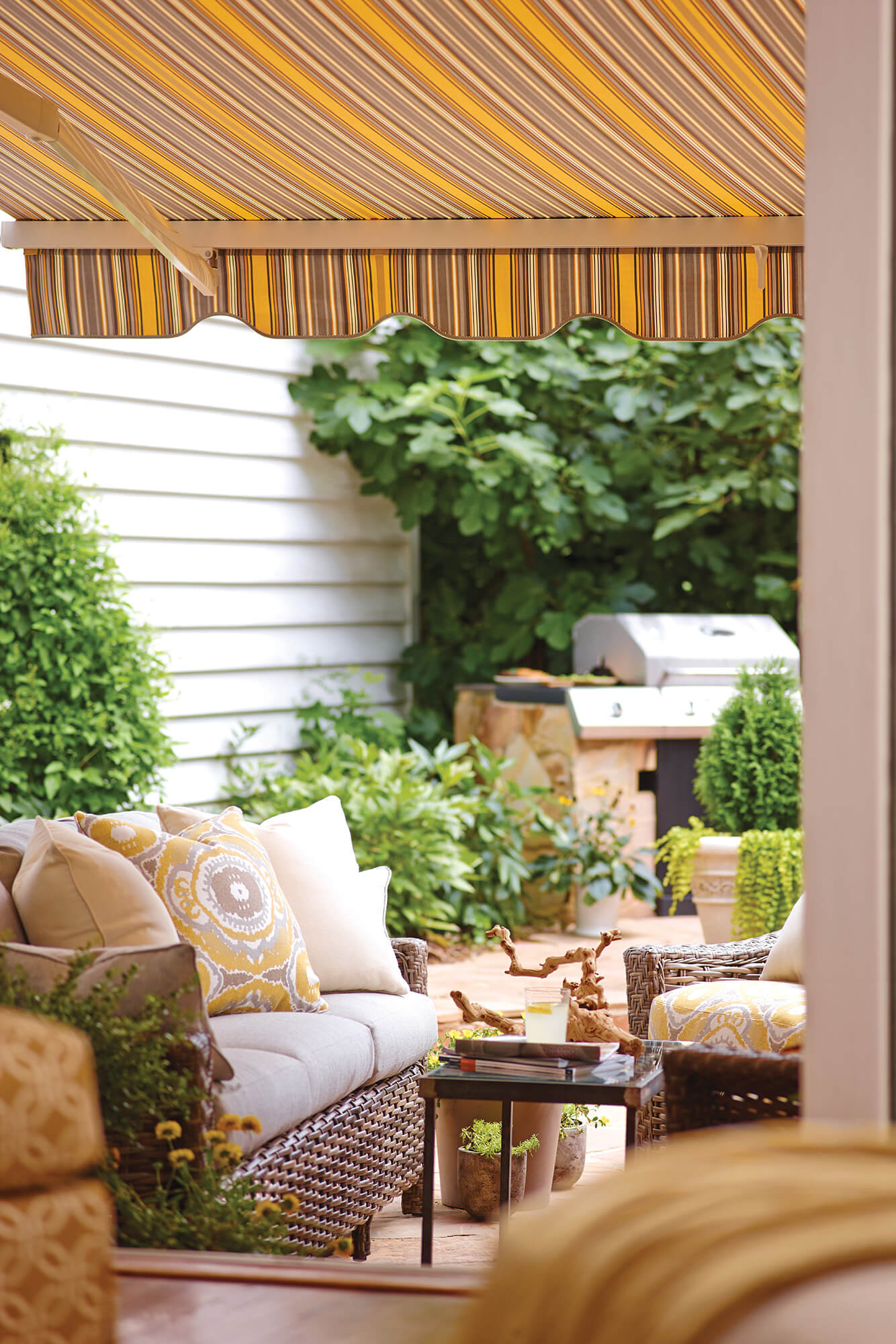 View underneath yellow striped retractable awning on a patio