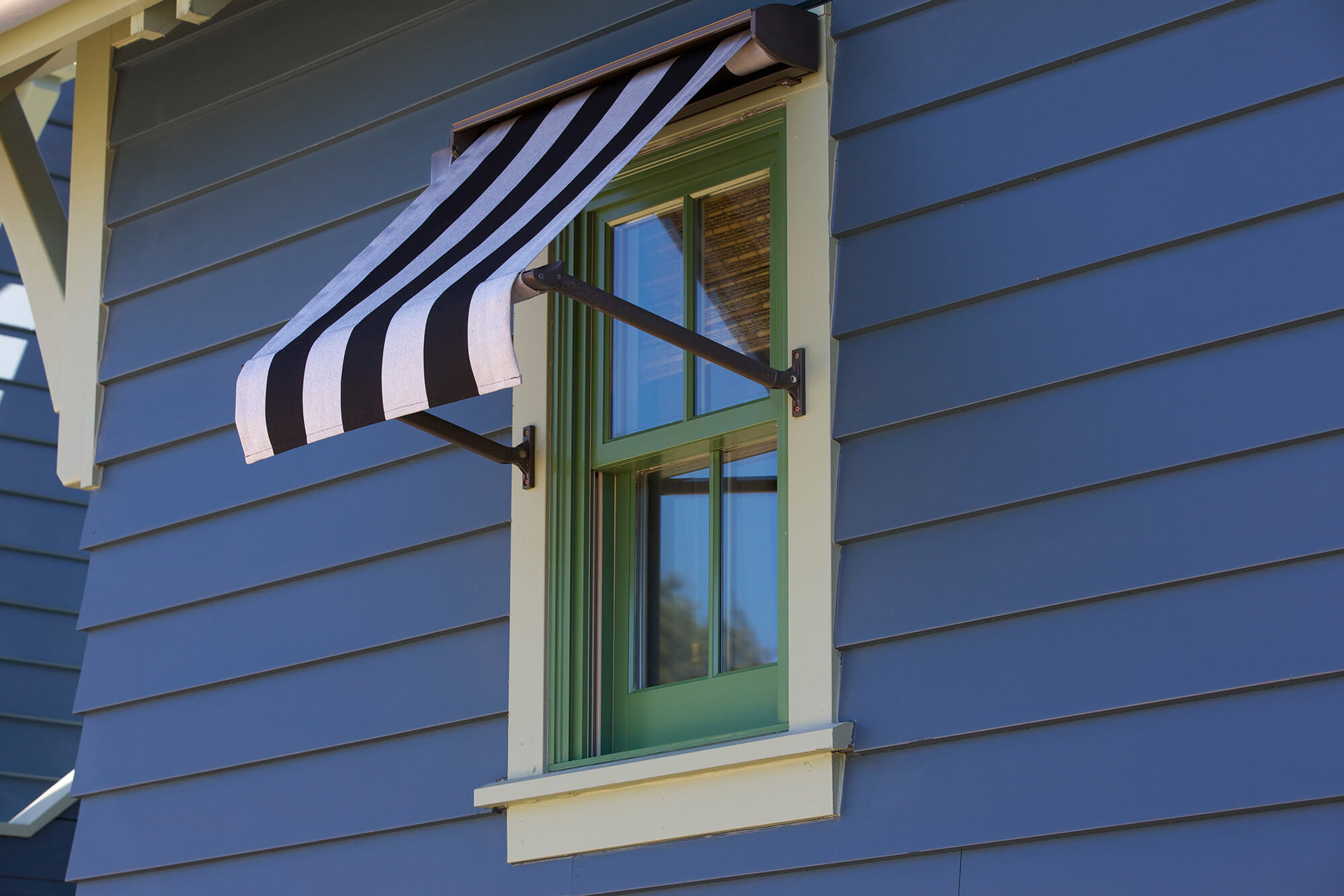 Window Awning Made With Black And White Striped Sunbrella Fabric