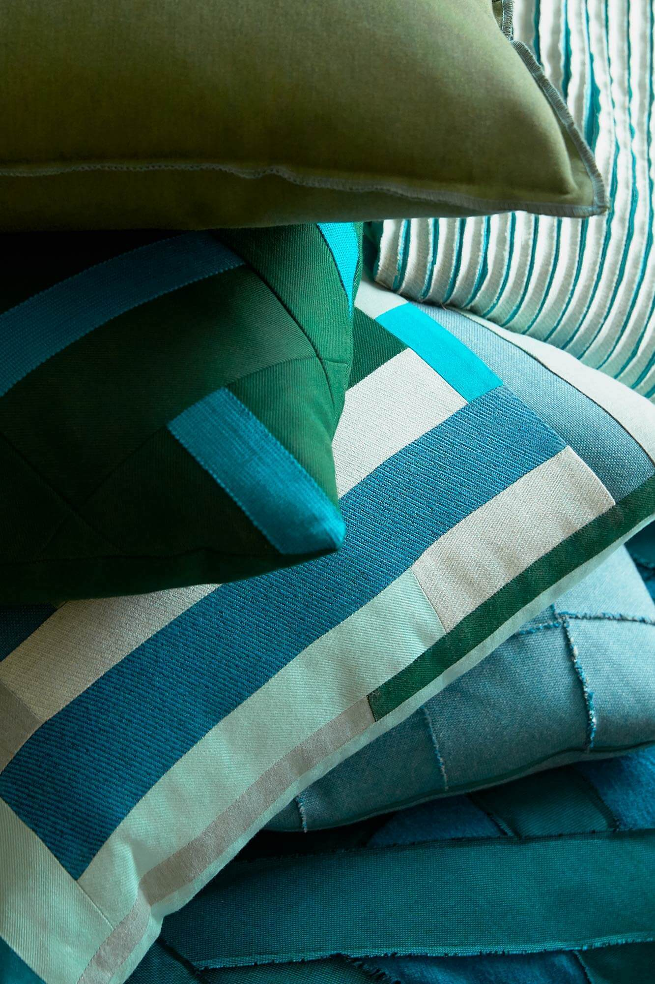 Decorative pillows made using Sunbrella upholstery fabrics stacked