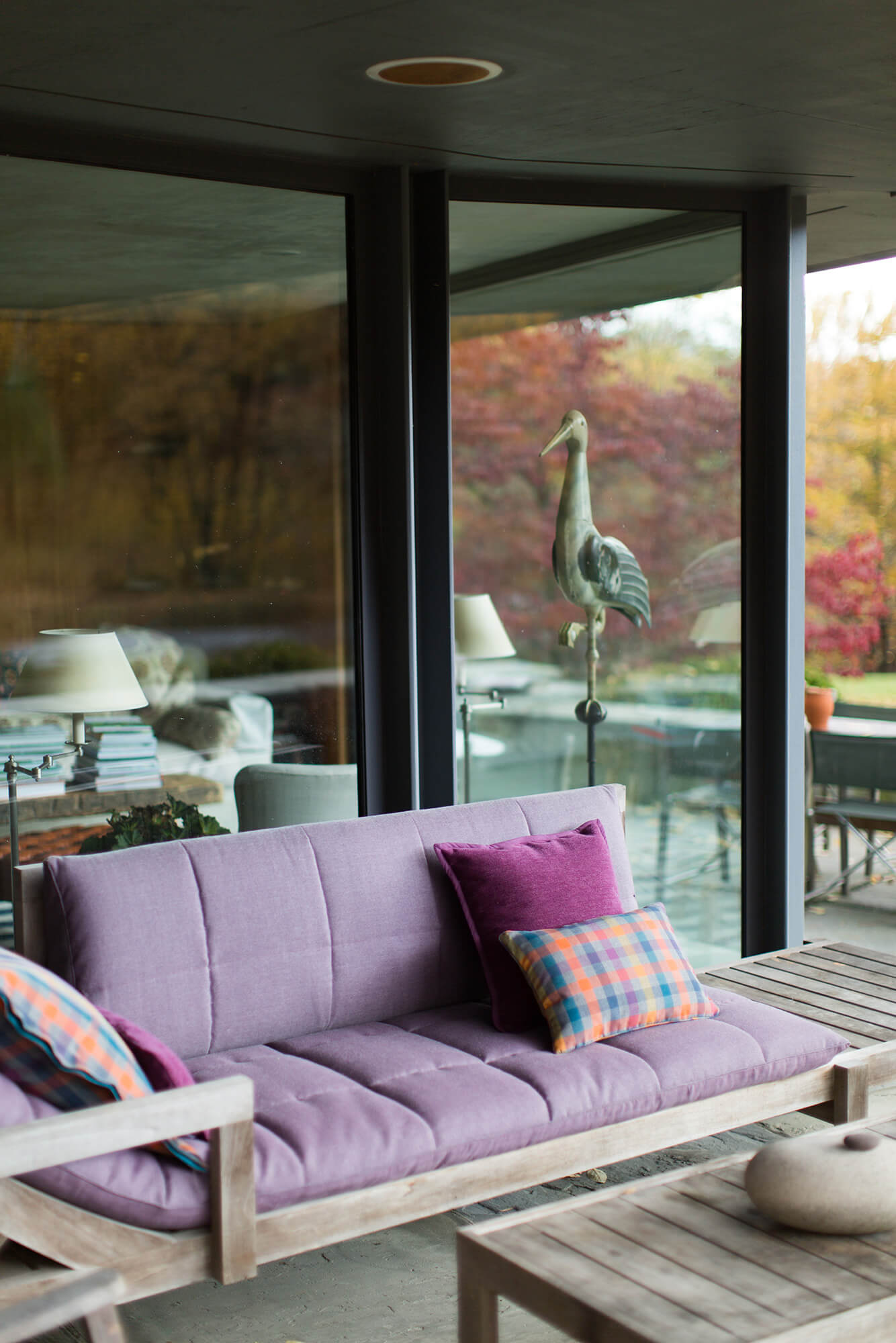 Patio With Sofa Featuring Cushions Made Using Purple Sunbrella Fabric And Bold Patterned Throw Pillows