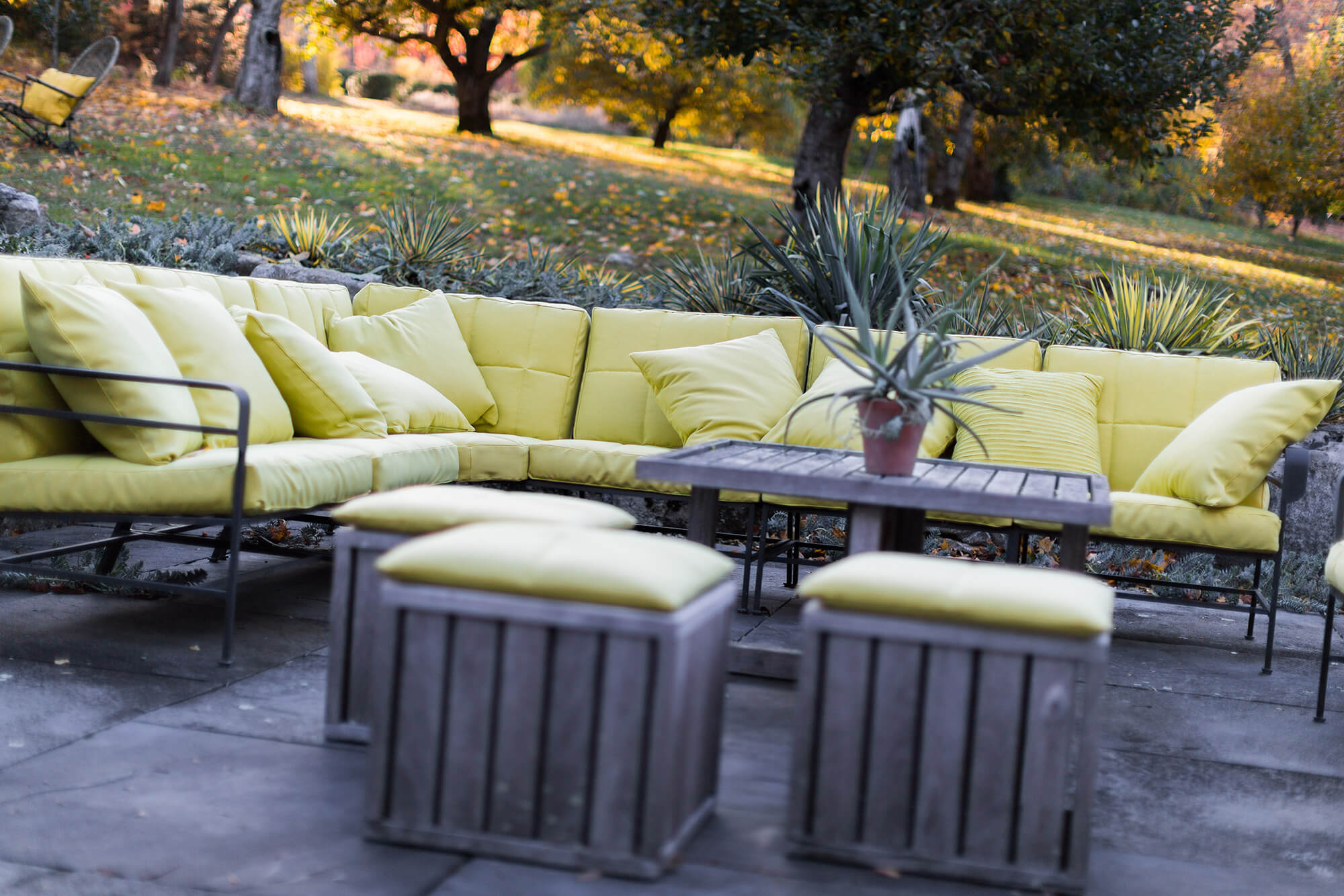 sofa on outdoor patio featuring cushions with green sunbrella fabric - Garden Furniture Lebanon